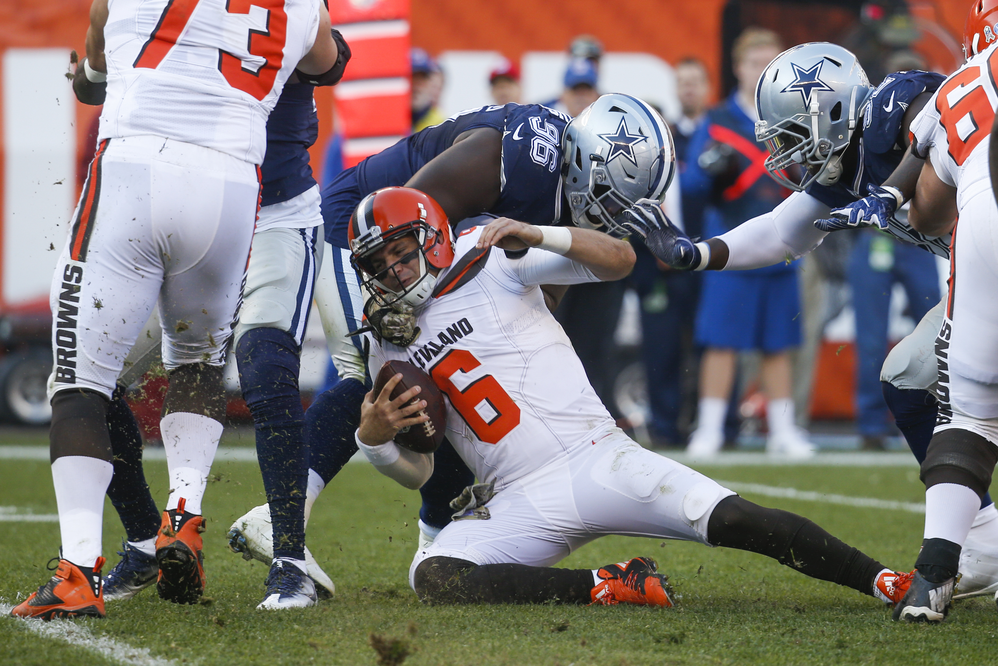 Cleveland Browns quarterback Cody Kessler (6) is sacked by Dallas Cowboys defensive tackle Maliek Collins (96) in the second half of an NFL football game, Sunday, Nov. 6, 2016, in Cleveland. (AP Photo/Ron Schwane)