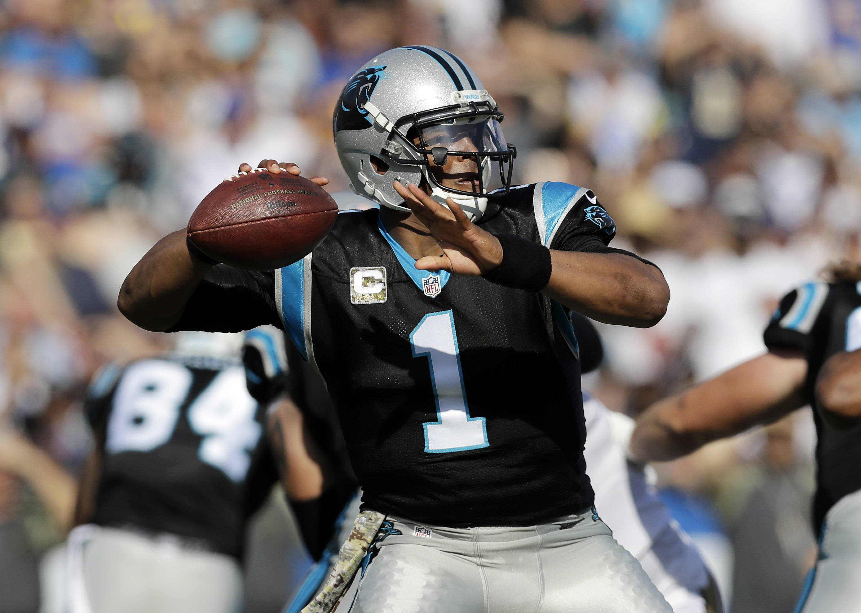 Carolina Panthers quarterback Cam Newton passes during the first half of an NFL football game against the Los Angeles Rams, Sunday, Nov. 6, 2016, in Los Angeles. (AP Photo/Jae C. Hong)