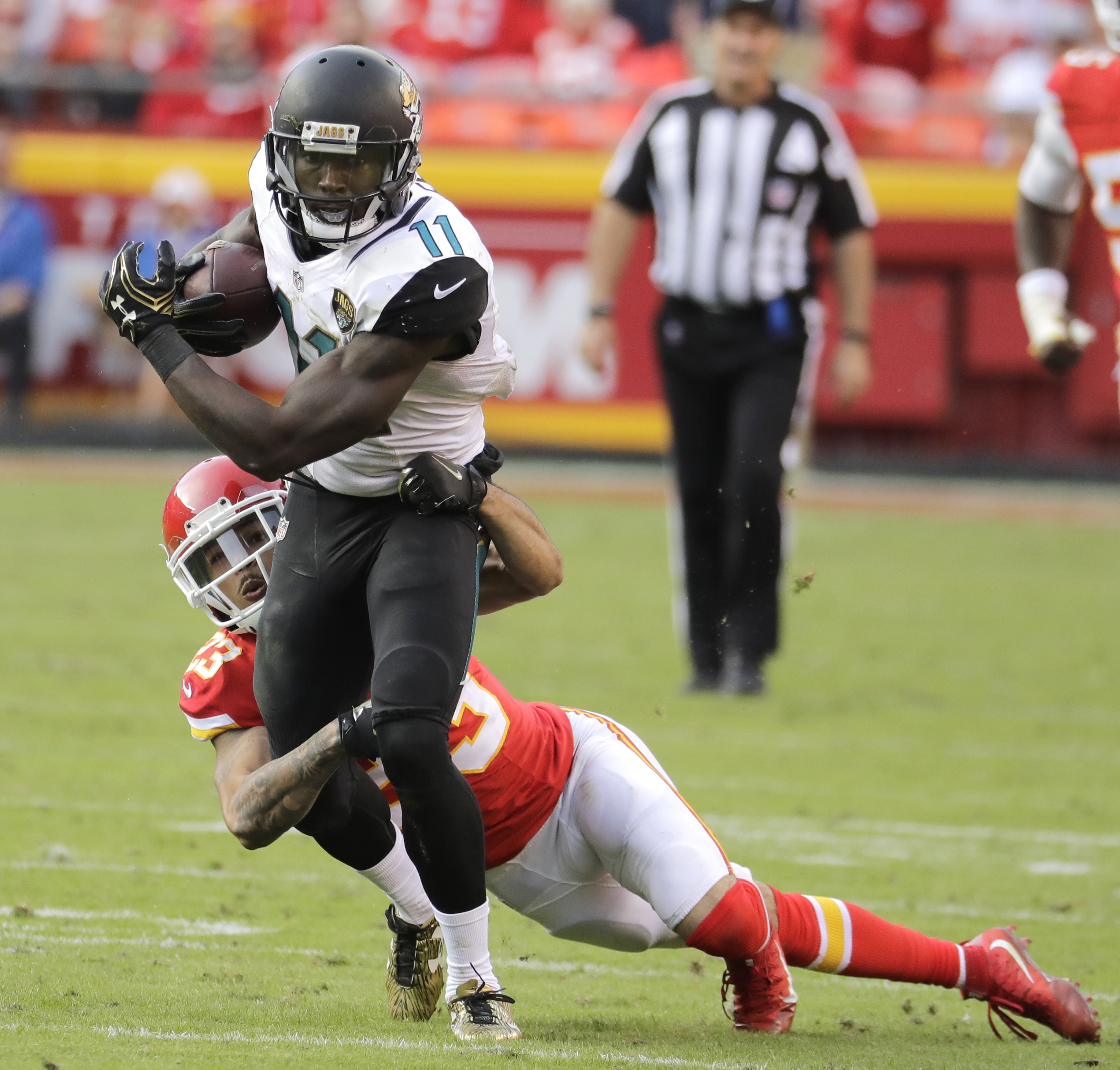 Jacksonville Jaguars wide receiver Marqise Lee (11) is tackled by Kansas City Chiefs defensive back Eric Berry (29) during the second half of an NFL football game in Kansas City, Mo., Sunday, Nov. 6, 2016. (AP Photo/Charlie Riedel)