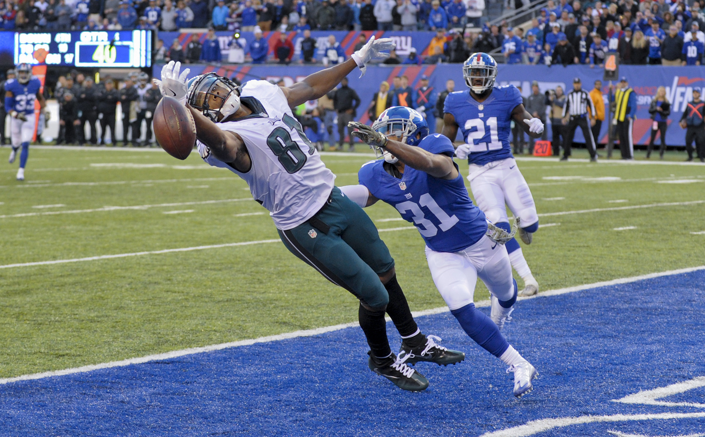 Philadelphia Eagles wide receiver Jordan Matthews (81) can't make the catch in the end zone under pressure from New York Giants cornerback Trevin Wade (31) on 4th down during the fourth quarter of an NFL football game, Sunday, Nov. 6, 2016, in East Ruther