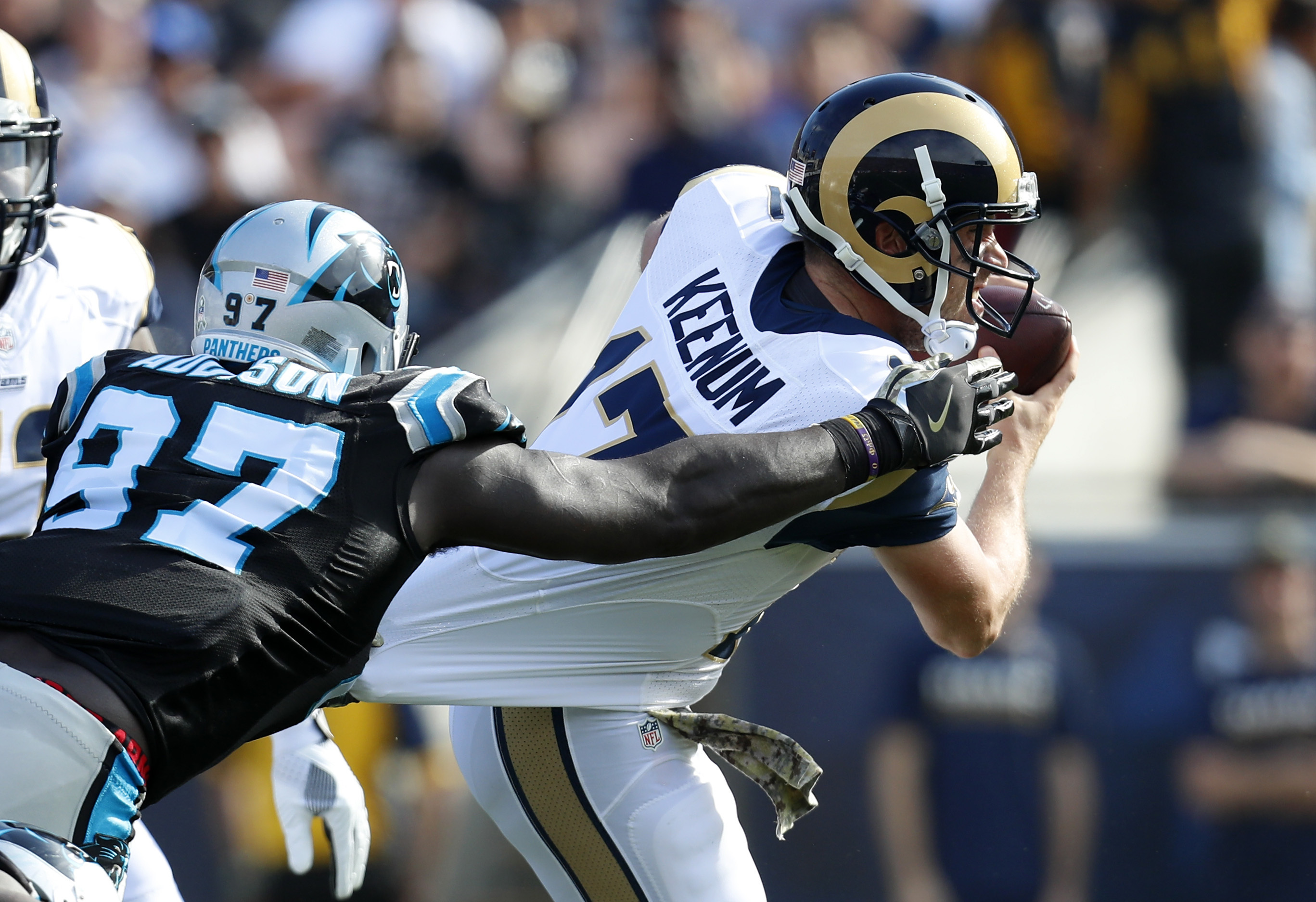 Los Angeles Rams quarterback Case Keenum, right, is sacked by Carolina Panthers defensive end Mario Addison during the first half of an NFL football game, Sunday, Nov. 6, 2016, in Los Angeles. (AP Photo/Ryan Kang)