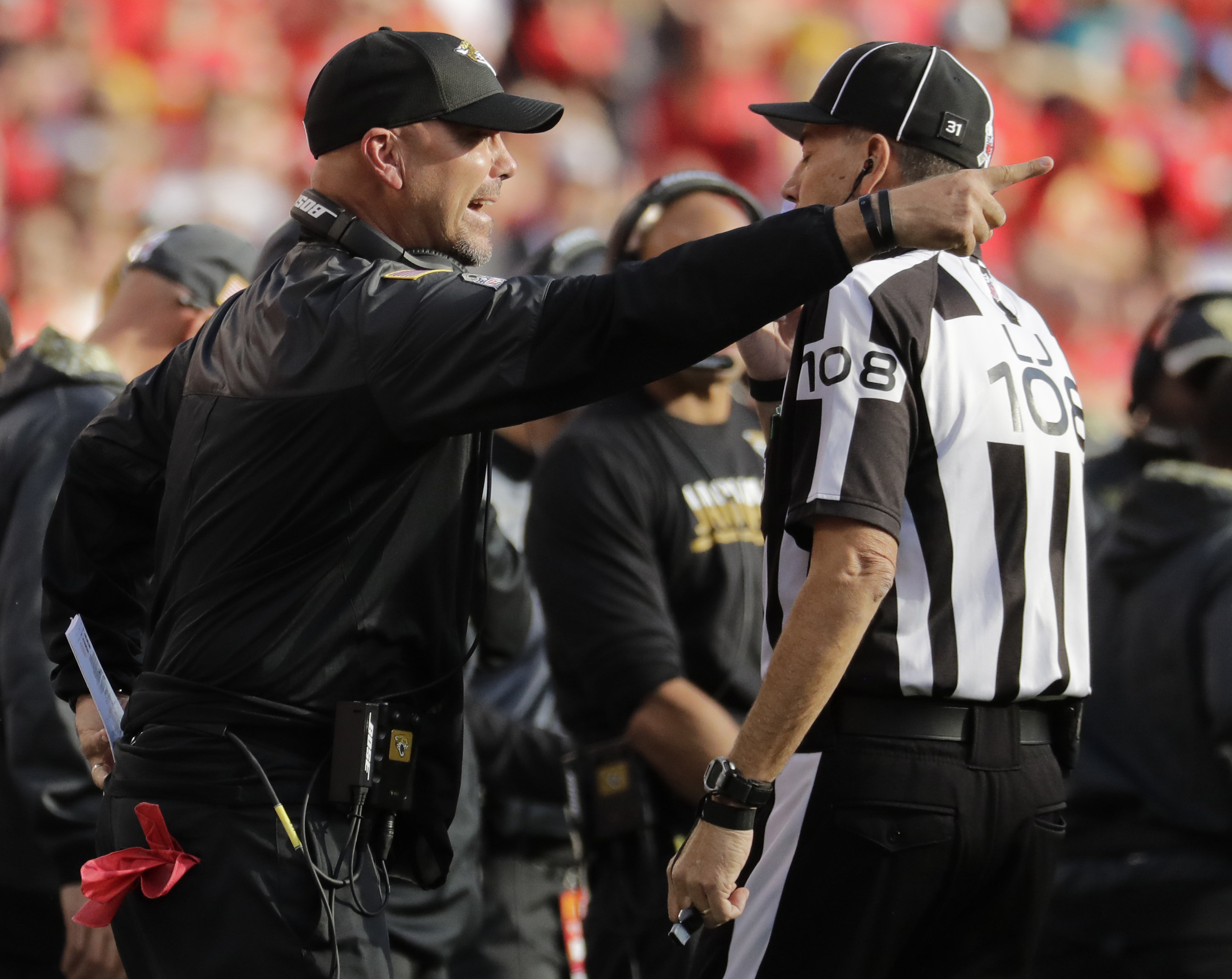 Jacksonville Jaguars head coach Gus Bradley, left, talks to line judge Gary Arthur (108) during the second half of an NFL football game against the Kansas City Chiefs in Kansas City, Mo., Sunday, Nov. 6, 2016. (AP Photo/Charlie Riedel)