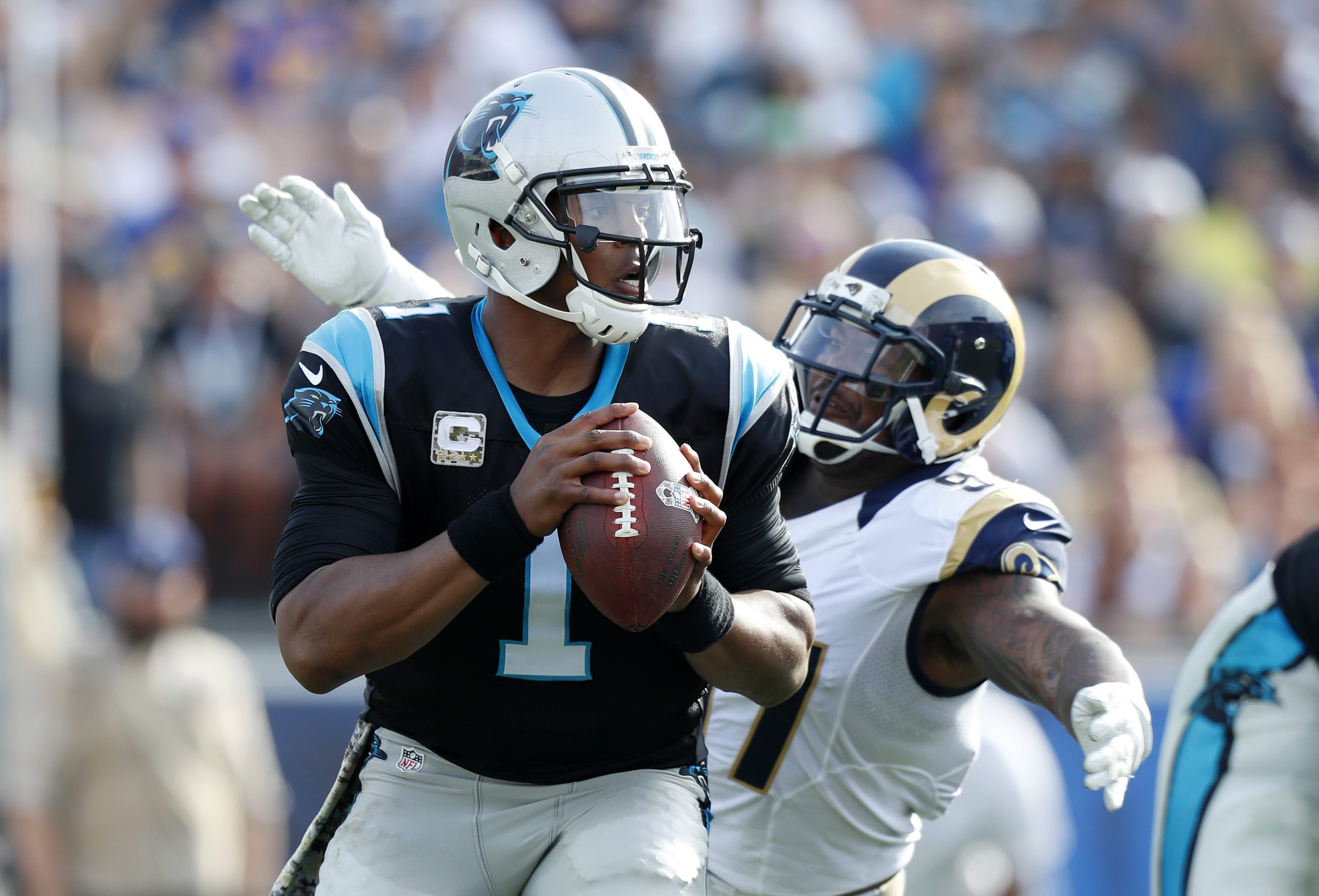 Carolina Panthers quarterback Cam Newton, left, is sacked by Los Angeles Rams defensive end Eugene Sims during the first half of an NFL football game, Sunday, Nov. 6, 2016, in Los Angeles. (AP Photo/Ryan Kang)