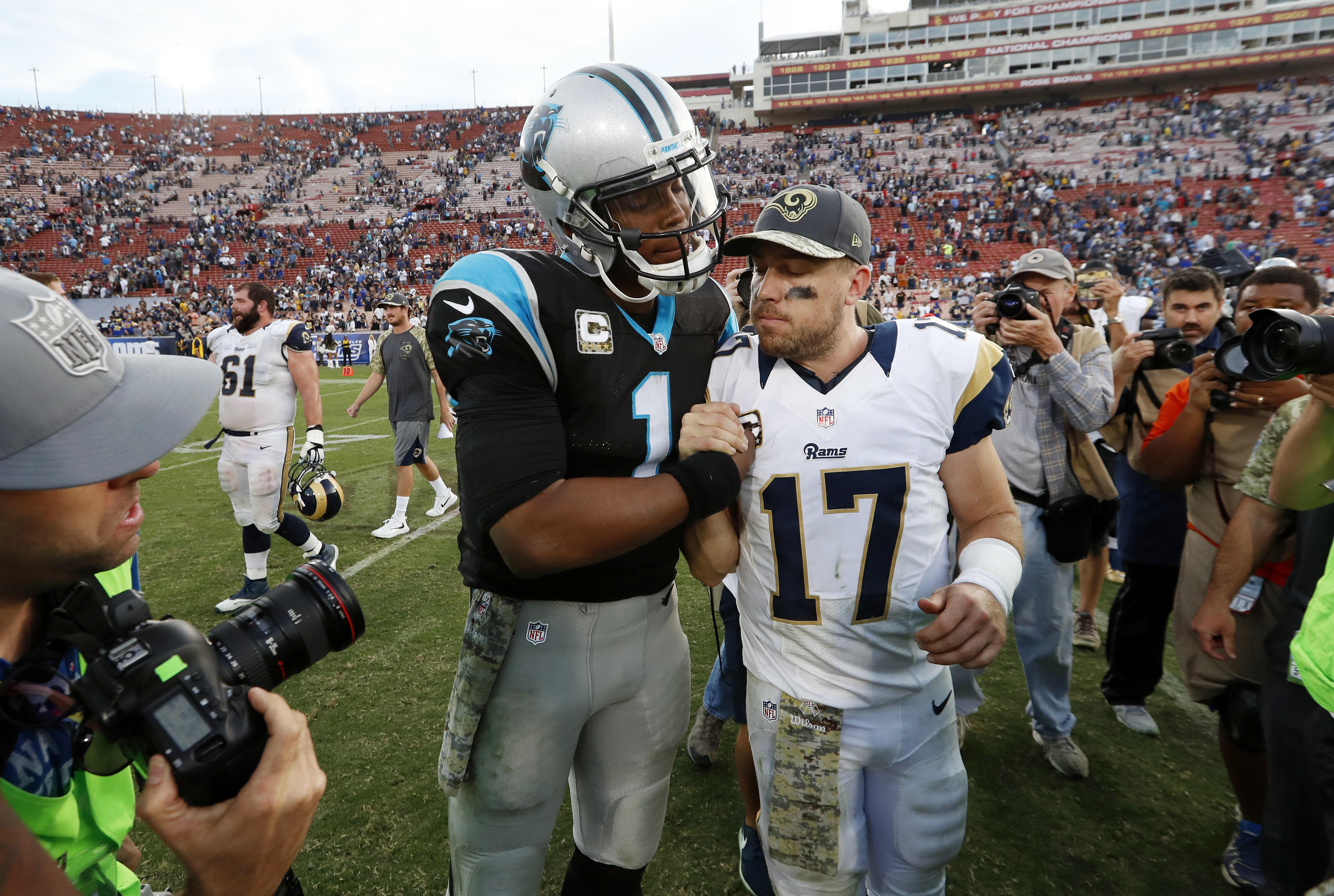 Carolina Panthers quarterback Cam Newton, center left, shakes hands with Los Angeles Rams quarterback Case Keenum after the Panthers defeated the Rams in an NFL football game, Sunday, Nov. 6, 2016, in Los Angeles. (AP Photo/Ryan Kang)