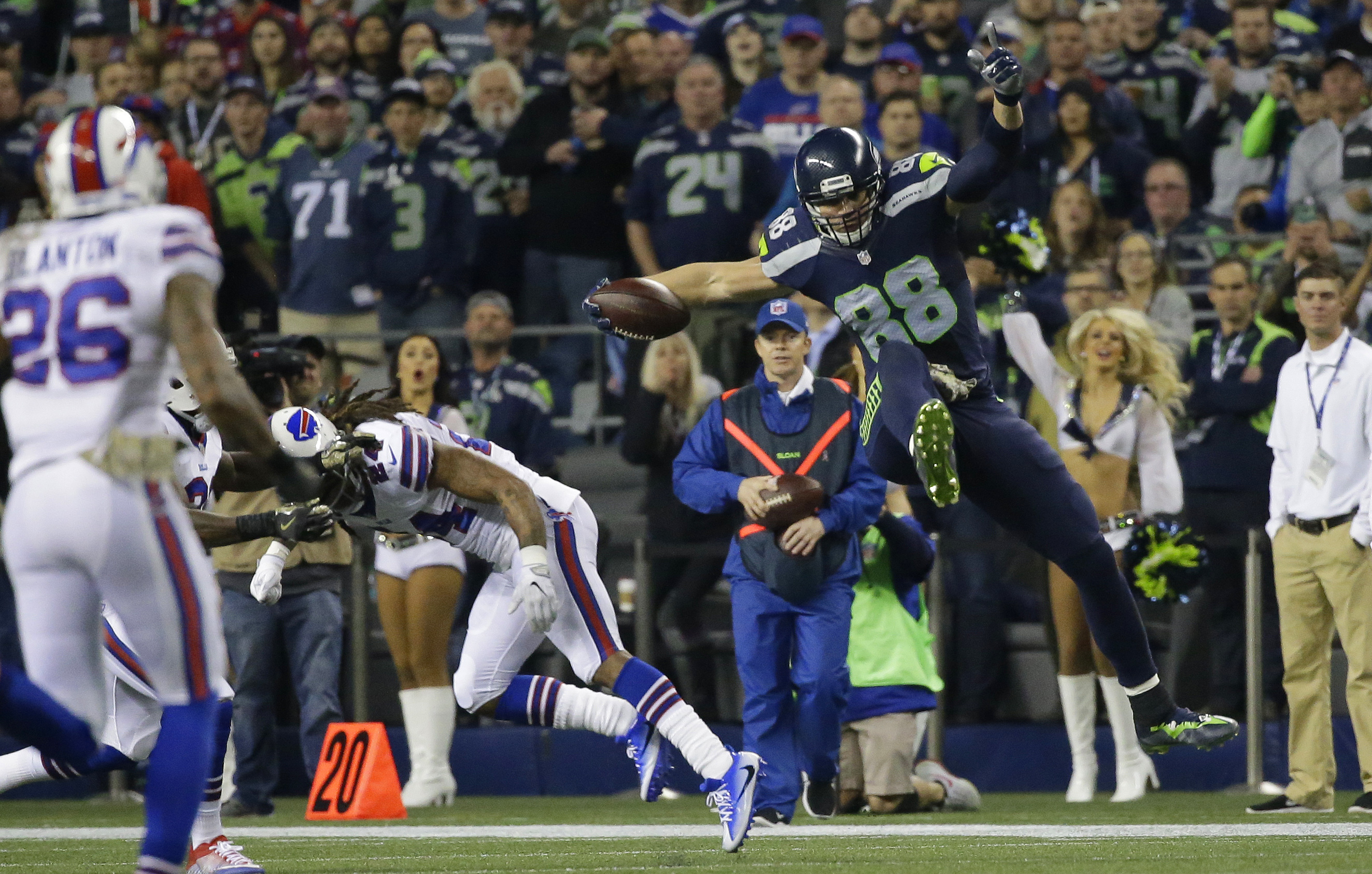 Seattle Seahawks tight end Jimmy Graham (88) leaps over Buffalo Bills cornerback Stephon Gilmore, second from left, in the first half of an NFL football game, Monday, Nov. 7, 2016, in Seattle. (AP Photo/Elaine Thompson)