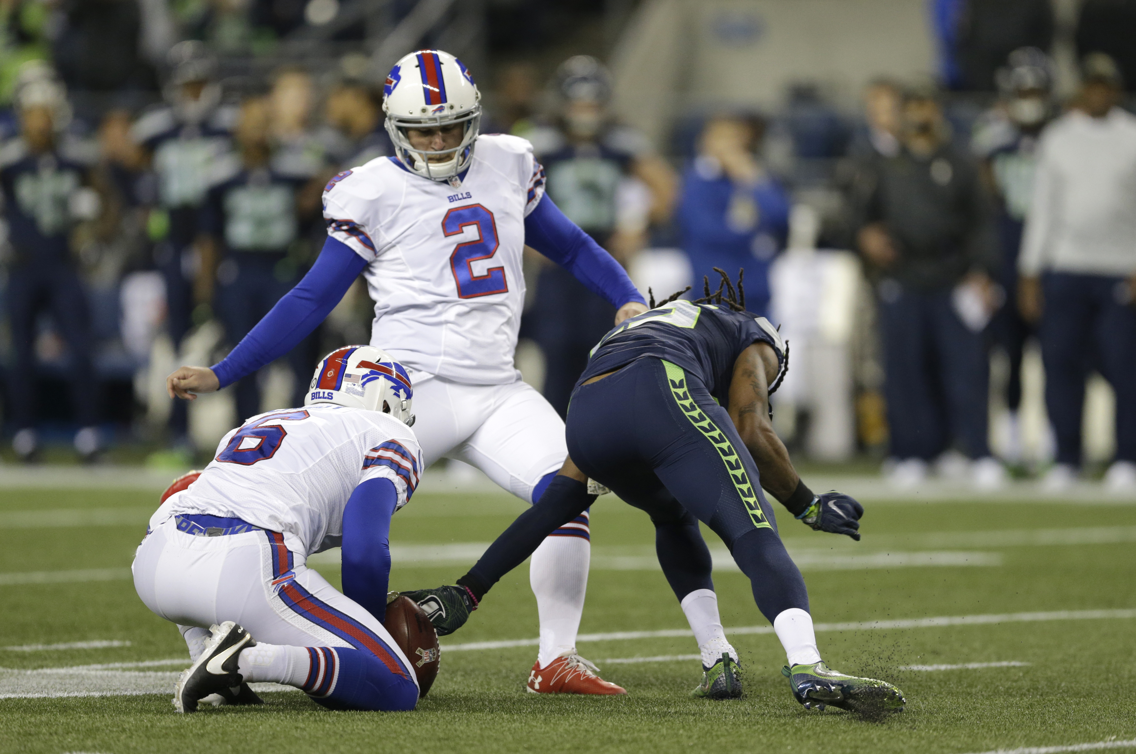 Seattle Seahawks cornerback Richard Sherman, right, reaches out to grab the ball on a failed field goal attempt by Buffalo Bills kicker Dan Carpenter (2) as Colton Schmidt holds in the first half of an NFL football game, Monday, Nov. 7, 2016, in Seattle.