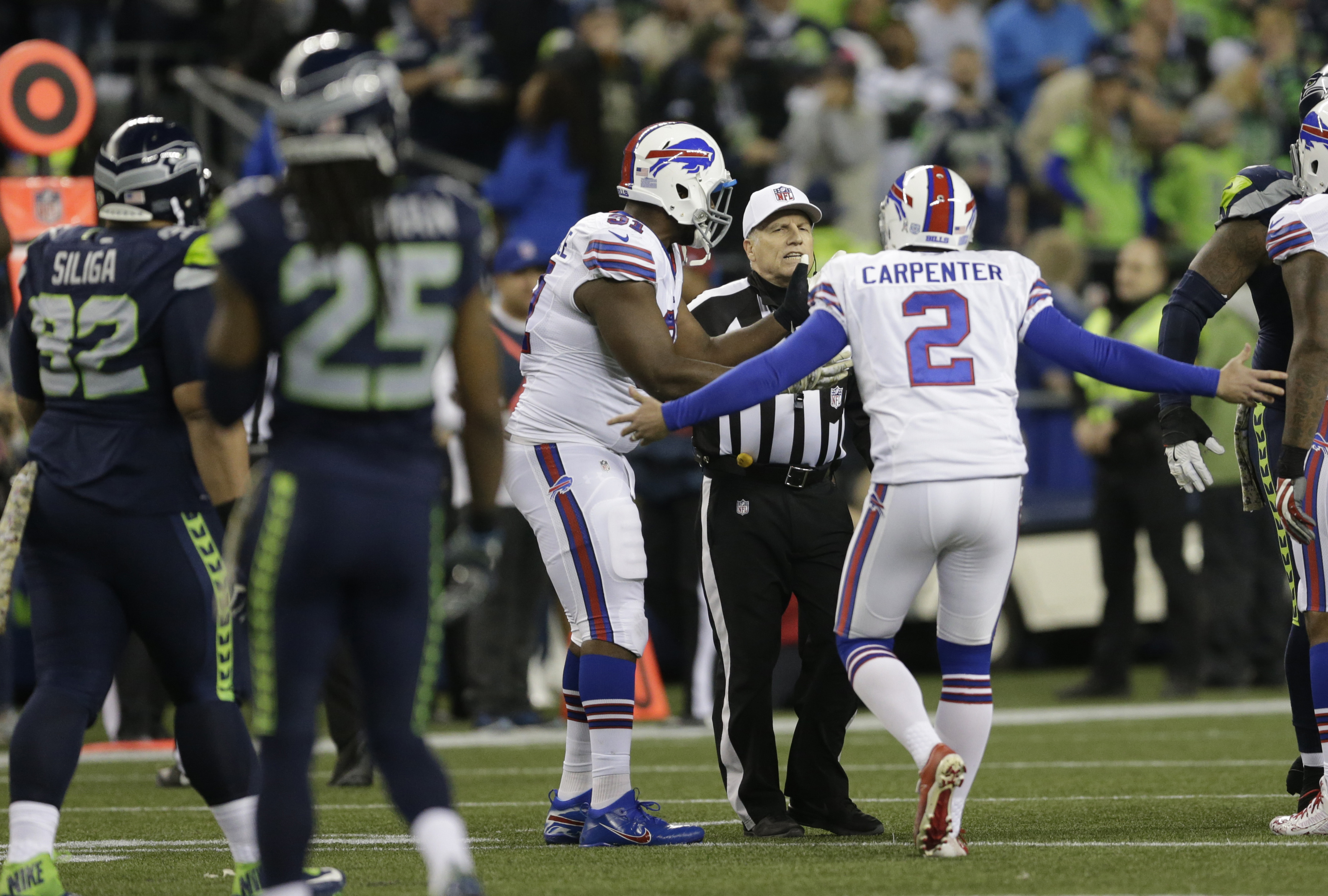 FILE - In this Monday, Nov. 7, 2016, file photo, Buffalo Bills kicker Dan Carpenter (2) complains to referee Walt Anderson late in the first half of an NFL football game against the Seattle Seahawks, in Seattle. Richard Sherman spent last week criticizing