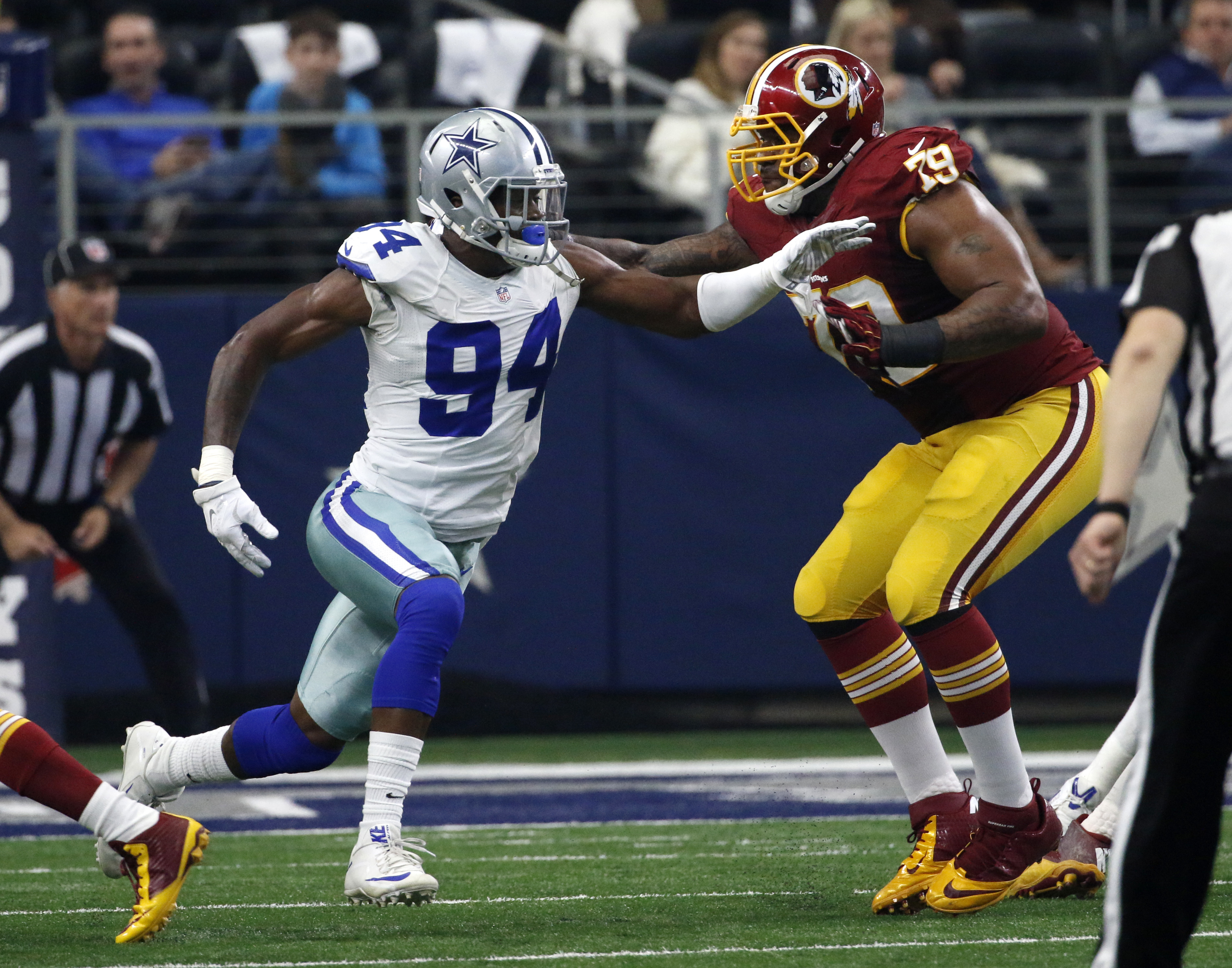 In this photo taken Jan. 3, 2016, Washington Redskins tackle Ty Nsekhe (79) blocks Dallas Cowboys defensive end Randy Gregory (94) during an NFL football game in Arlington, Texas. Not too long ago, Nsekhe was making $150 a week playing arena football and