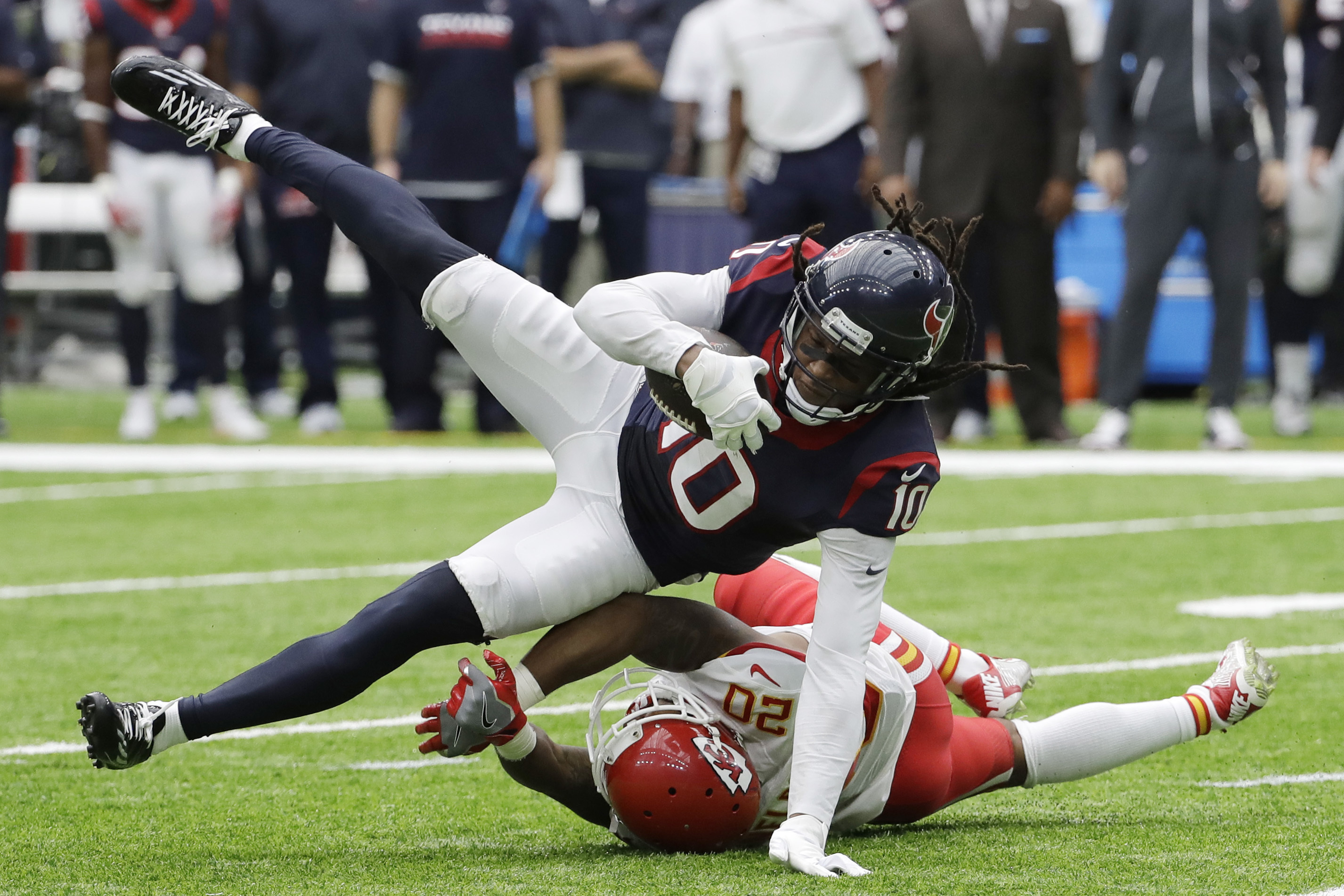 FILE - In this Sept. 18, 2016, file photo, Houston Texans wide receiver DeAndre Hopkins (10) is upended by Kansas City Chiefs cornerback Steven Nelson (20) during the second half of an NFL football game in Houston. The Texans have been dreadful on the roa
