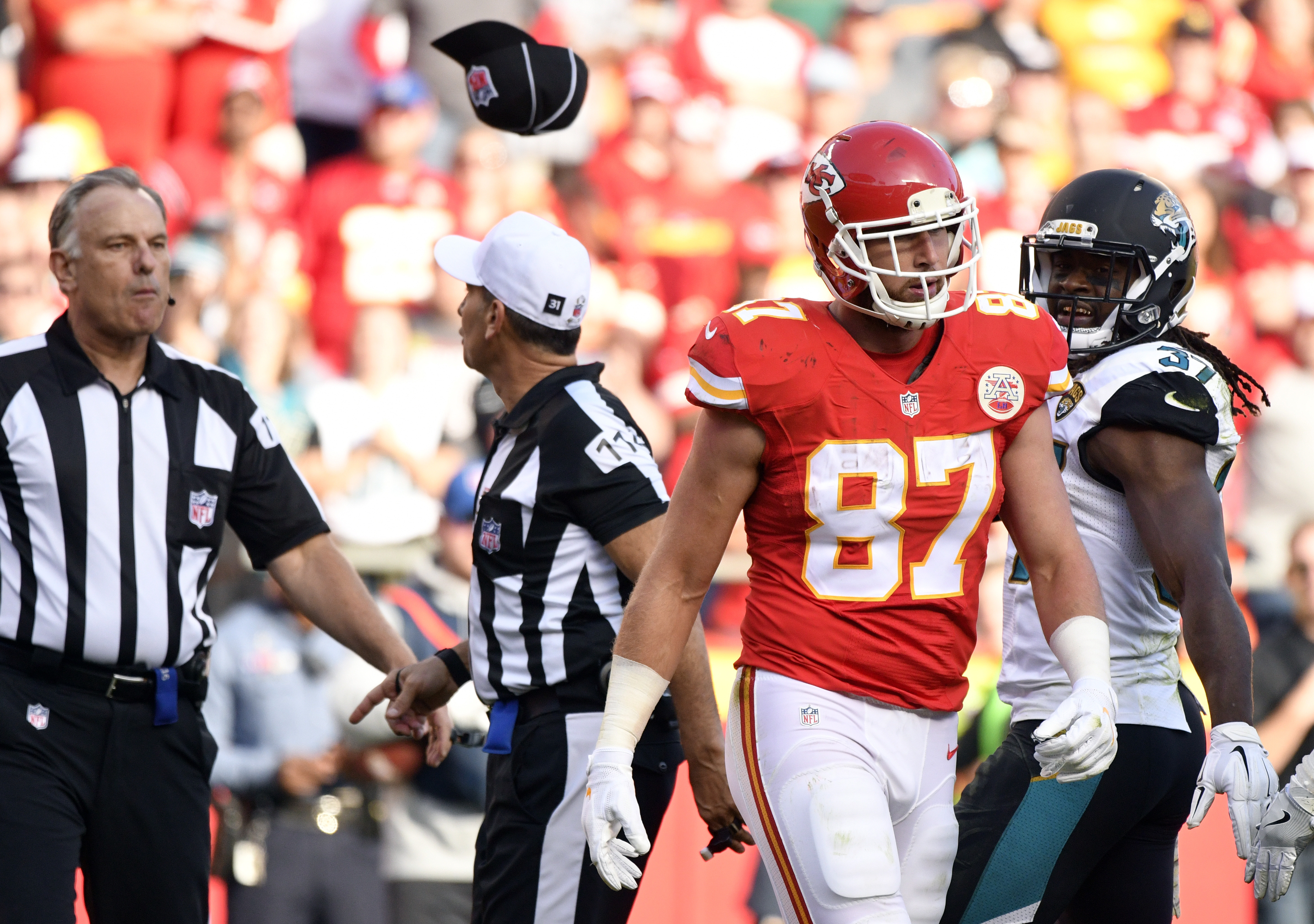 FILE - In this Nov. 6, 2016, file photo, field Judge Mike Weatherford, left, throws his cap toward Kansas City Chiefs tight end Travis Kelce (87) after Kelce, who was ejected for unsportsmanlike conduct, threw a towel in his direction during the second ha