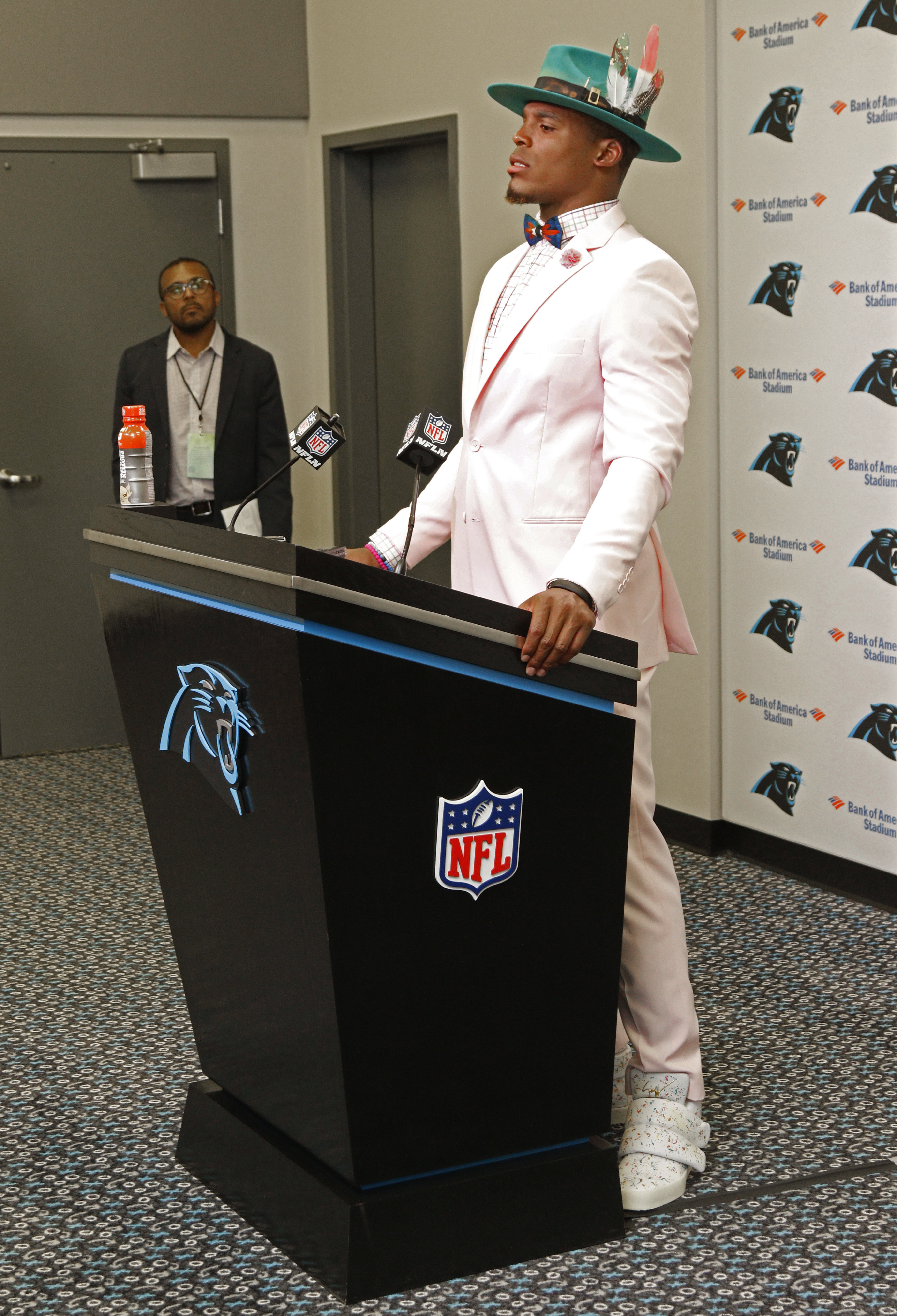 FILE - In this Sunday, Oct. 30, 2016, file photo, Carolina Panthers' Cam Newton speaks to the media about the officiating after an NFL football game against the Arizona Cardinals, in Charlotte, N.C. Quarterbacks say they take too many dirty hits. Receiver