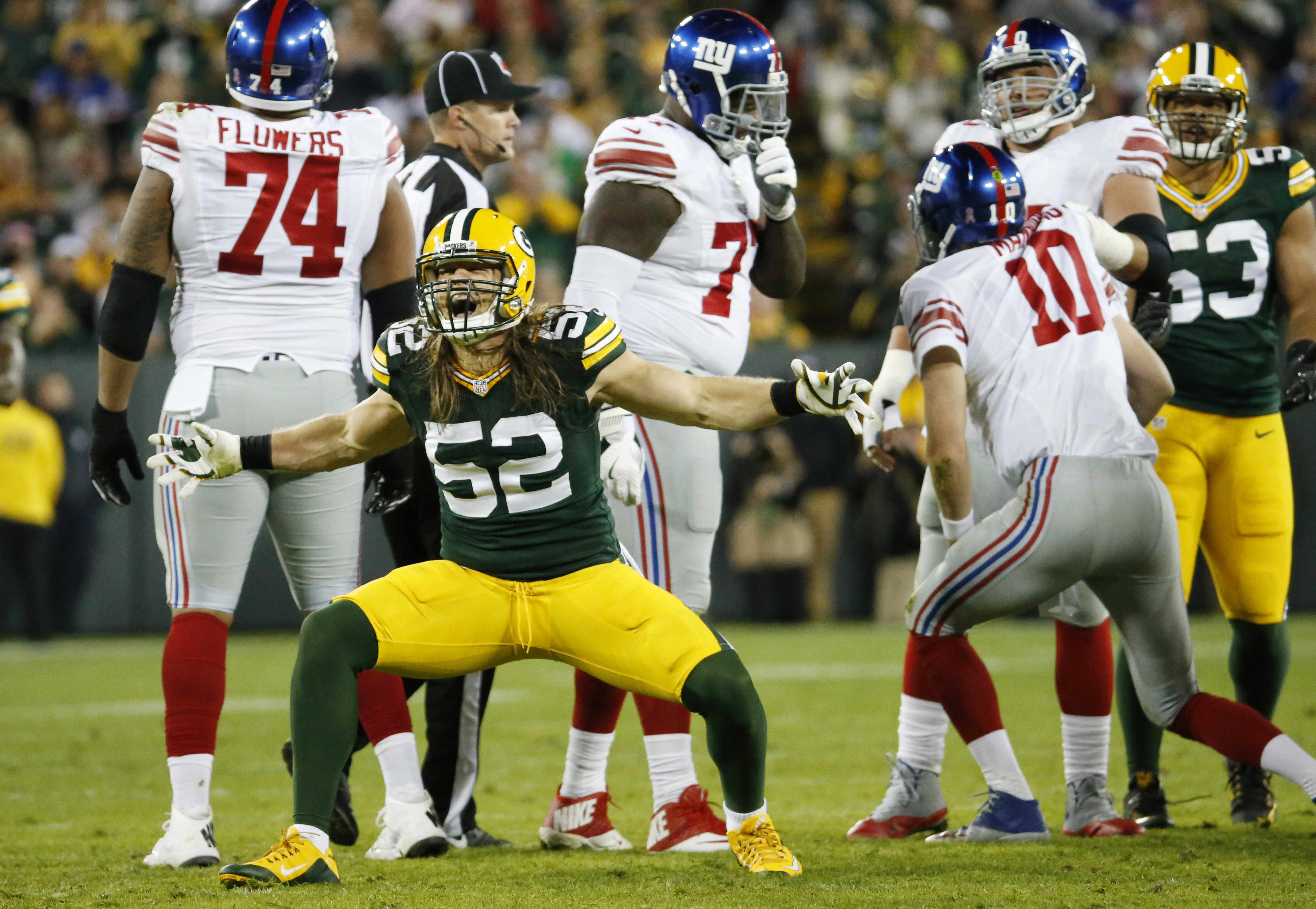 FILE - In this Oct. 9, 2016, file photo, Green Bay Packers' Clay Matthews celebrates a sack of New York Giants quarterback Eli Manning (10) during an NFL football game in Green Bay, Wis. After getting 14 sacks over the first four games, the Packers pass r