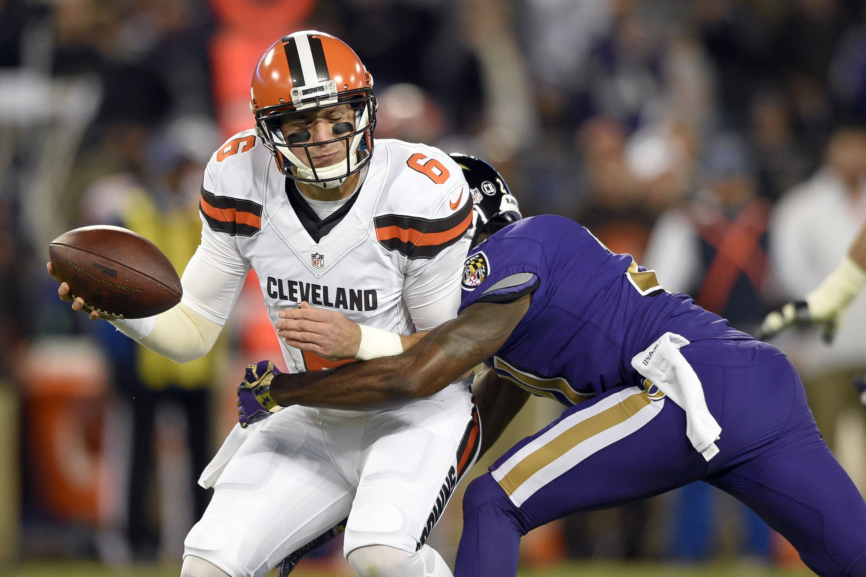 Cleveland Browns quarterback Cody Kessler, left, is sacked by Baltimore Ravens free safety Lardarius Webb during the first half an NFL football game, Thursday, Nov. 10, 2016, in Baltimore. (AP Photo/Nick Wass)