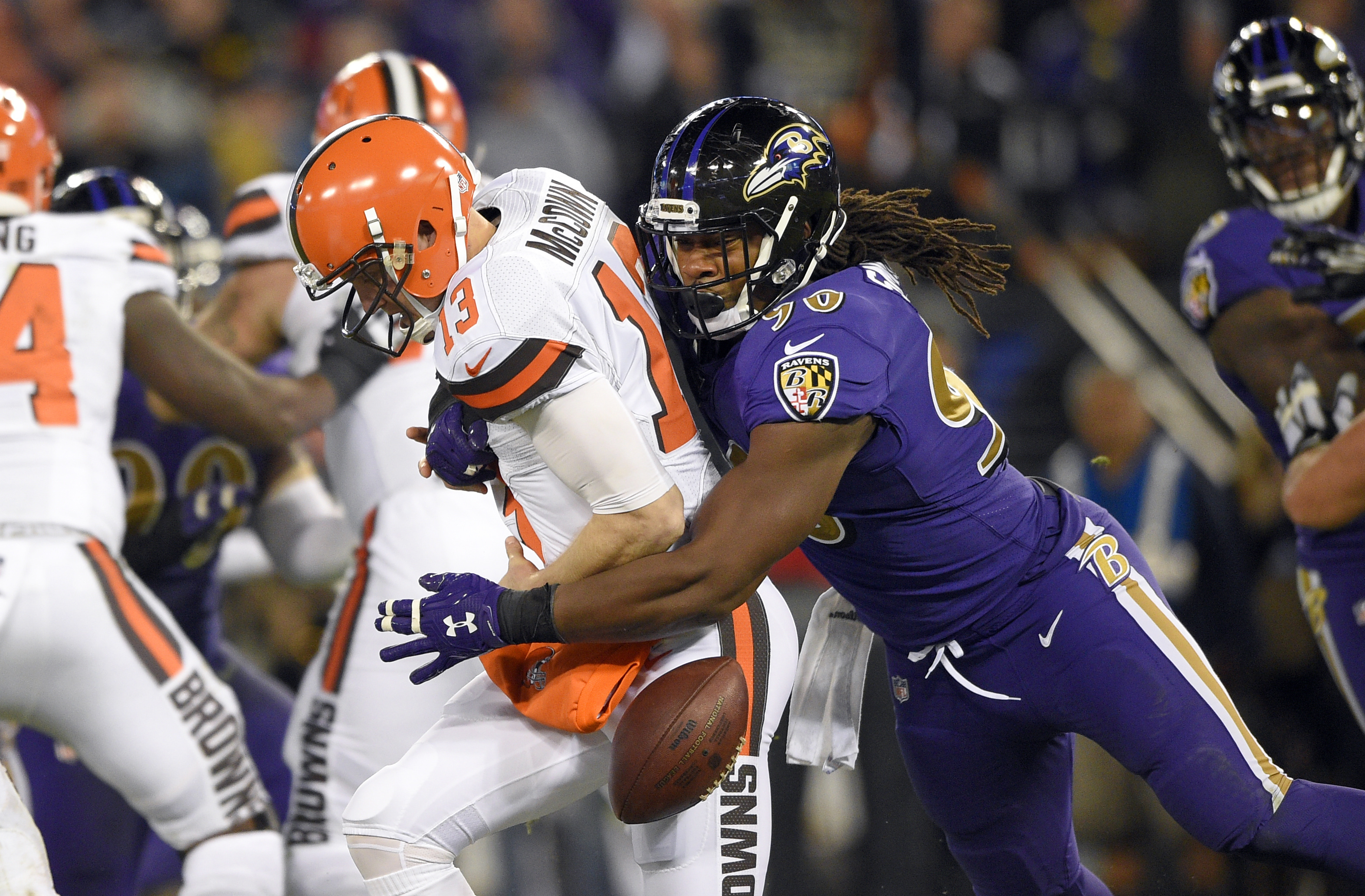 Cleveland Browns quarterback Josh McCown, left, fumbles the ball as he is sacked by Baltimore Ravens outside linebacker Za'Darius Smith during the second half an NFL football game, Thursday, Nov. 10, 2016, in Baltimore. Cleveland recovered the ball on the