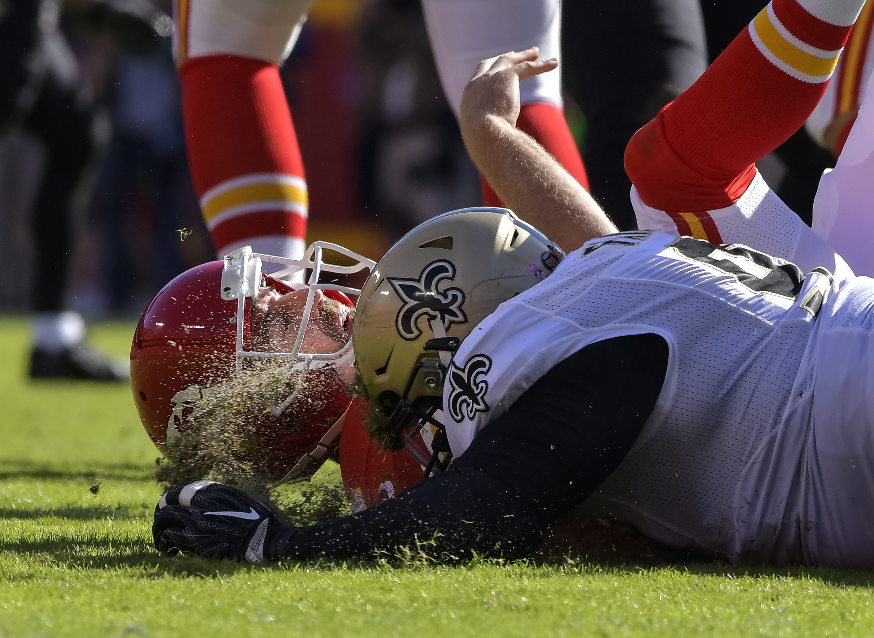 FILE - In this Oct. 23, 2016, file photo, Kansas City Chiefs quarterback Alex Smith (11) is knocked to the ground after throwing a pass, by New Orleans Saints defensive tackle Nick Fairley (90) during the second half of an NFL football game in Kansas City