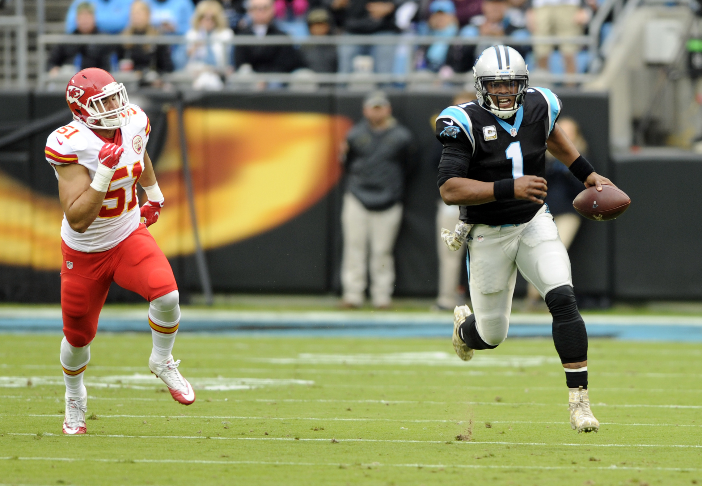 Carolina Panthers' Cam Newton (1) runs past Kansas City Chiefs' Frank Zombo (51) in the first half of an NFL football game in Charlotte, N.C., Sunday, Nov. 13, 2016. (AP Photo/Mike McCarn)