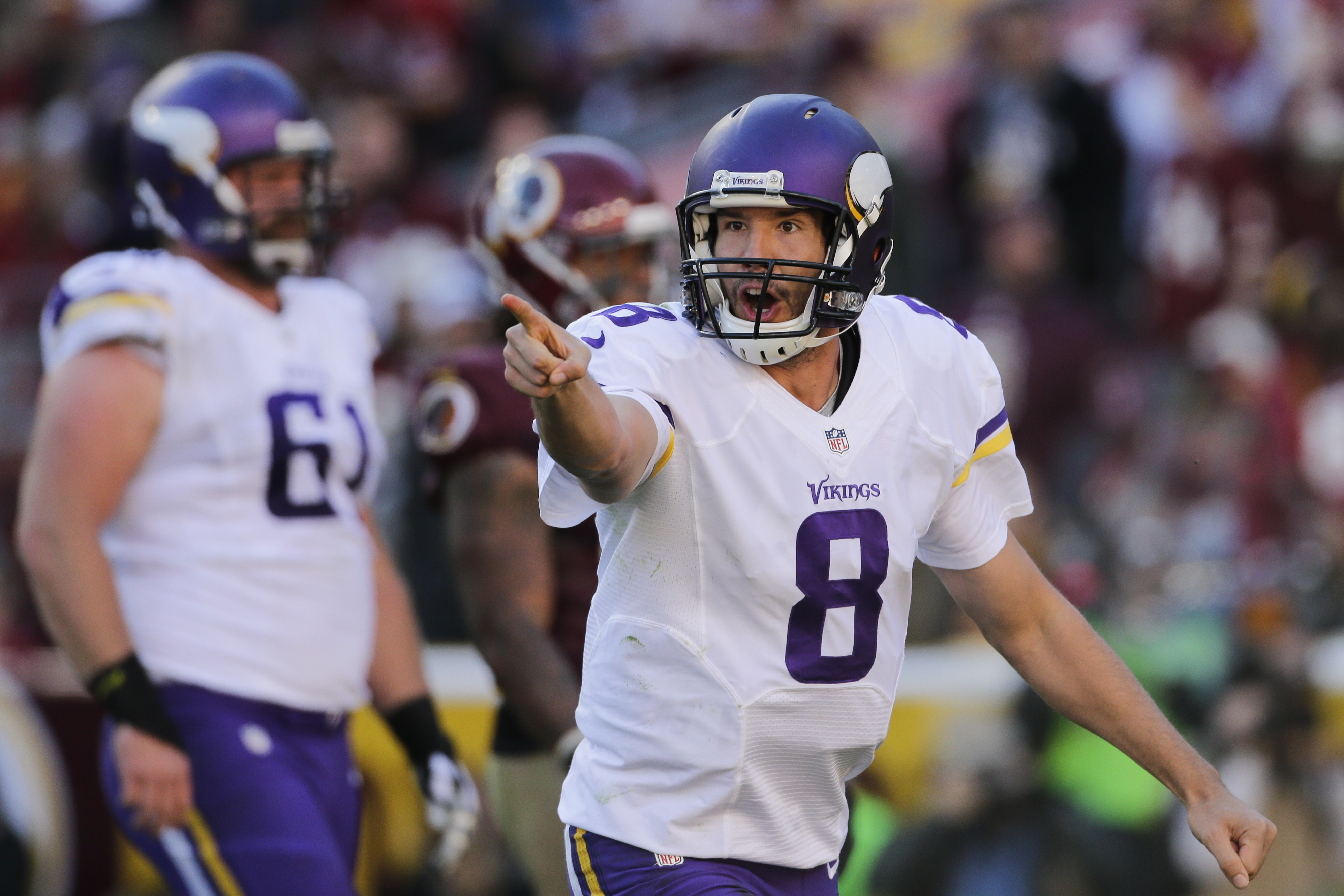 Minnesota Vikings quarterback Sam Bradford (8) celebrates wide receiver Adam Thielen's touchdown during the first half of an NFL football game against the Washington Redskins in Landover, Md., Sunday, Nov. 13, 2016. (AP Photo/Mark Tenally)