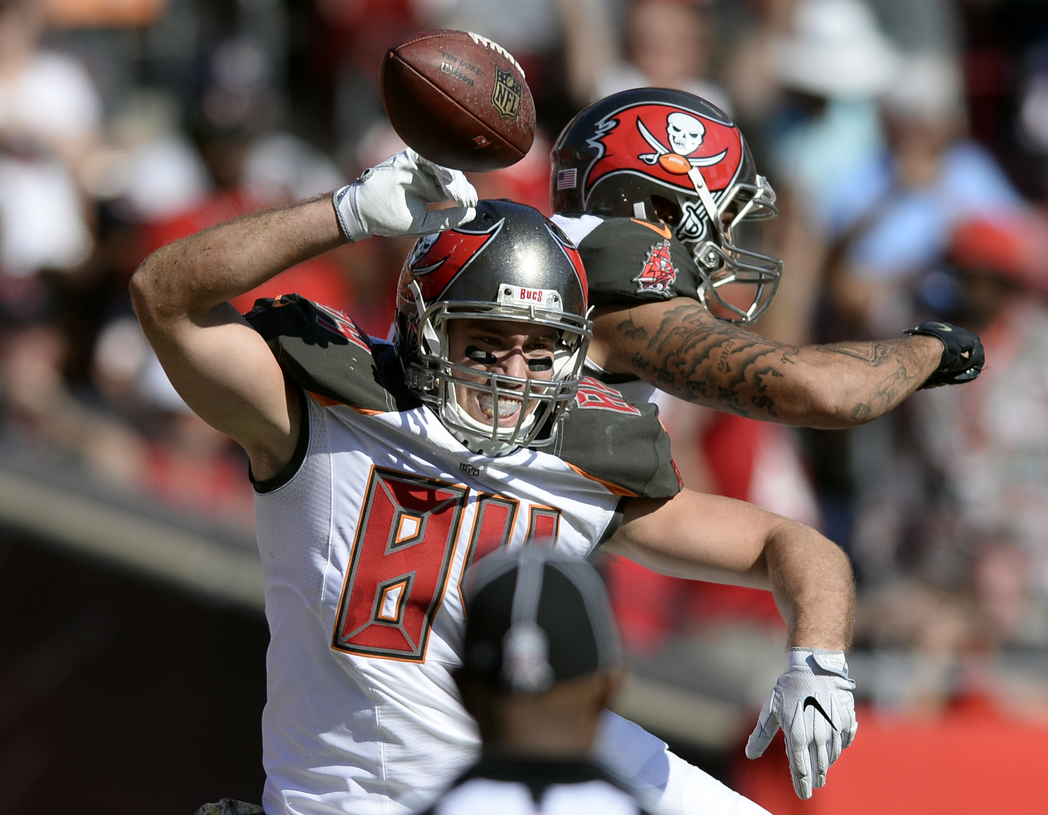 Tampa Bay Buccaneers tight end Cameron Brate (84) celebrates with wide receiver Mike Evans (13) after Brate caught a 10-yard touchdown pass against the Chicago Bears during the first quarter of an NFL football game Sunday, Nov. 13, 2016, in Tampa, Fla. (A