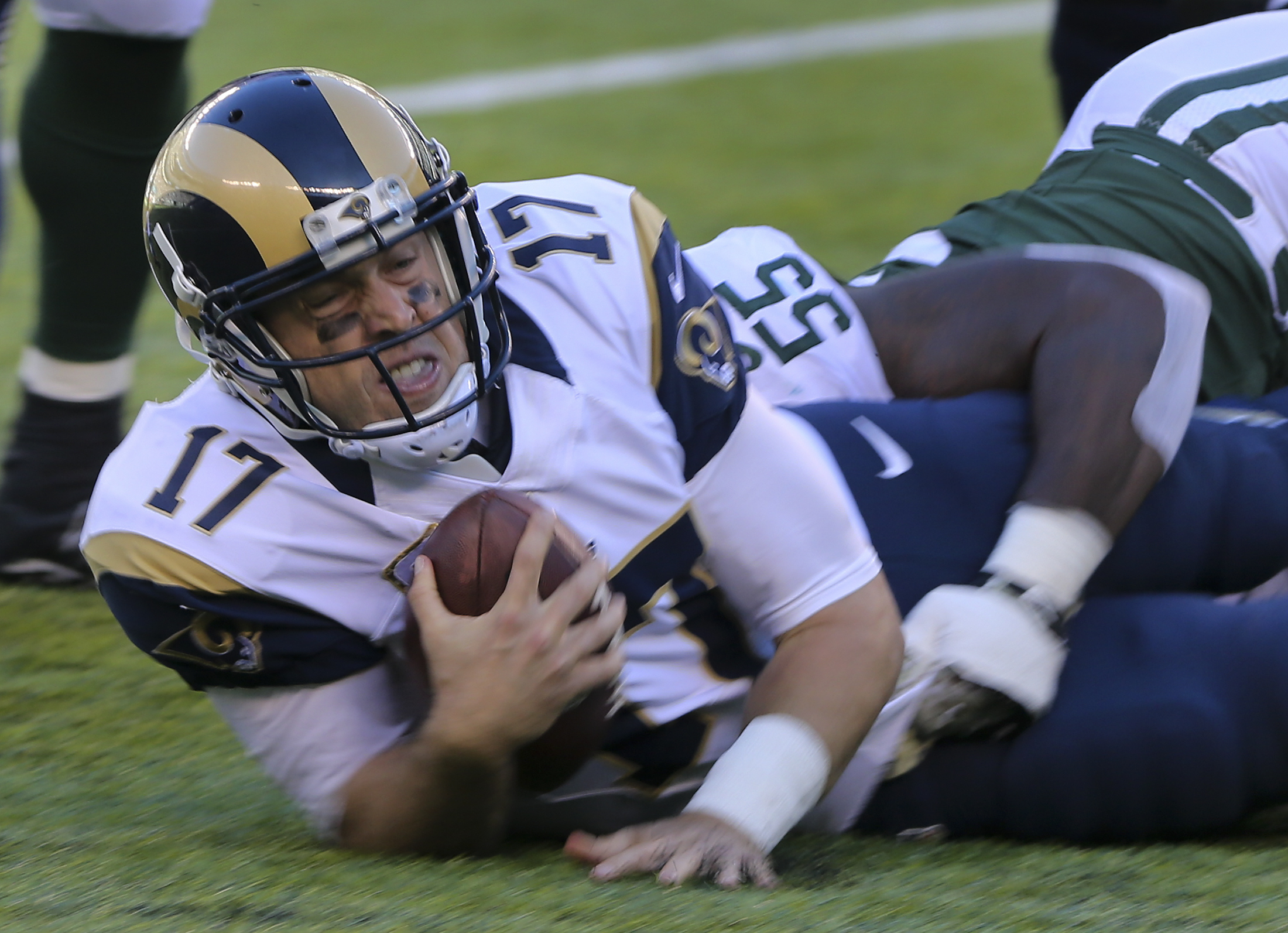 Los Angeles Rams quarterback Case Keenum (17) is tackled by New York Jets outside linebacker Lorenzo Mauldin (55) during the second quarter of an NFL football game, Sunday, Nov. 13, 2016, in East Rutherford, N.J. (AP Photo/Seth Wenig)