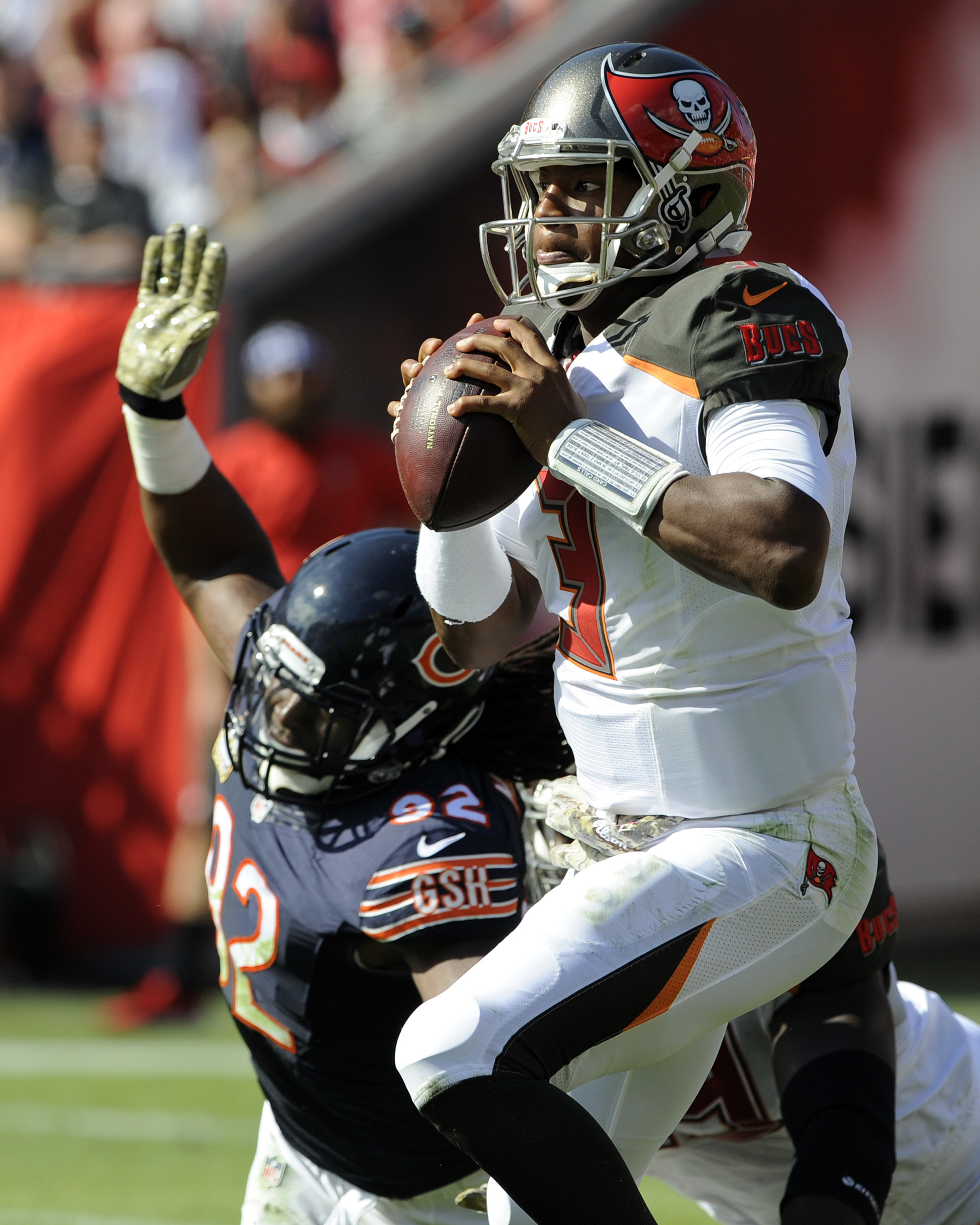 Tampa Bay Buccaneers quarterback Jameis Winston (3) scrambles away from Chicago Bears outside linebacker Pernell McPhee (92) during the second quarter of an NFL football game Sunday, Nov. 13, 2016, in Tampa, Fla. (AP Photo/Steve Nesius)