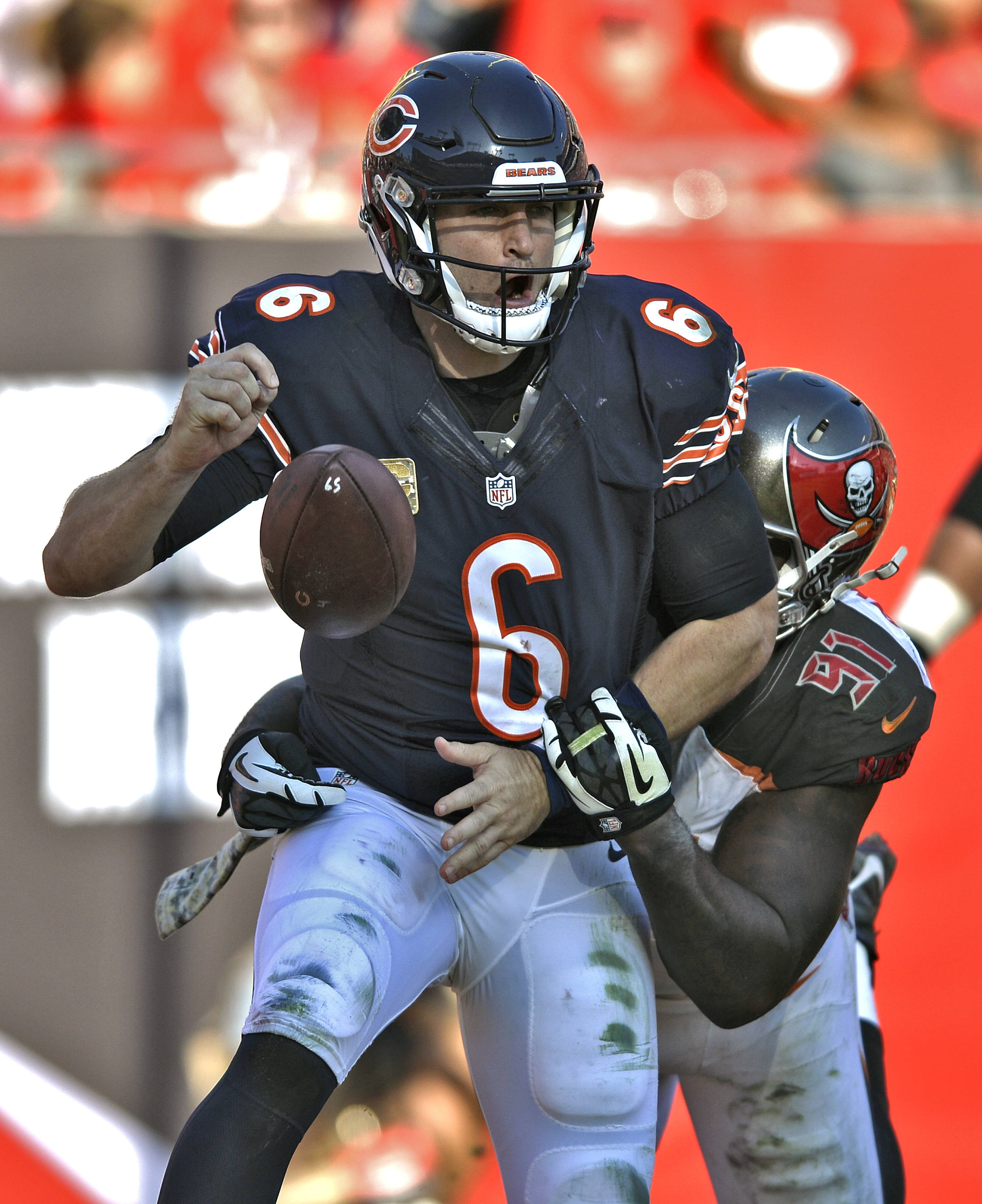 Chicago Bears quarterback Jay Cutler (6) fumbles as he is hit by Tampa Bay Buccaneers defensive end Robert Ayers (91) in the end zone during the third quarter of an NFL football game Sunday, Nov. 13, 2016, in Tampa, Fla. Cutler fumbled out of bounds resul