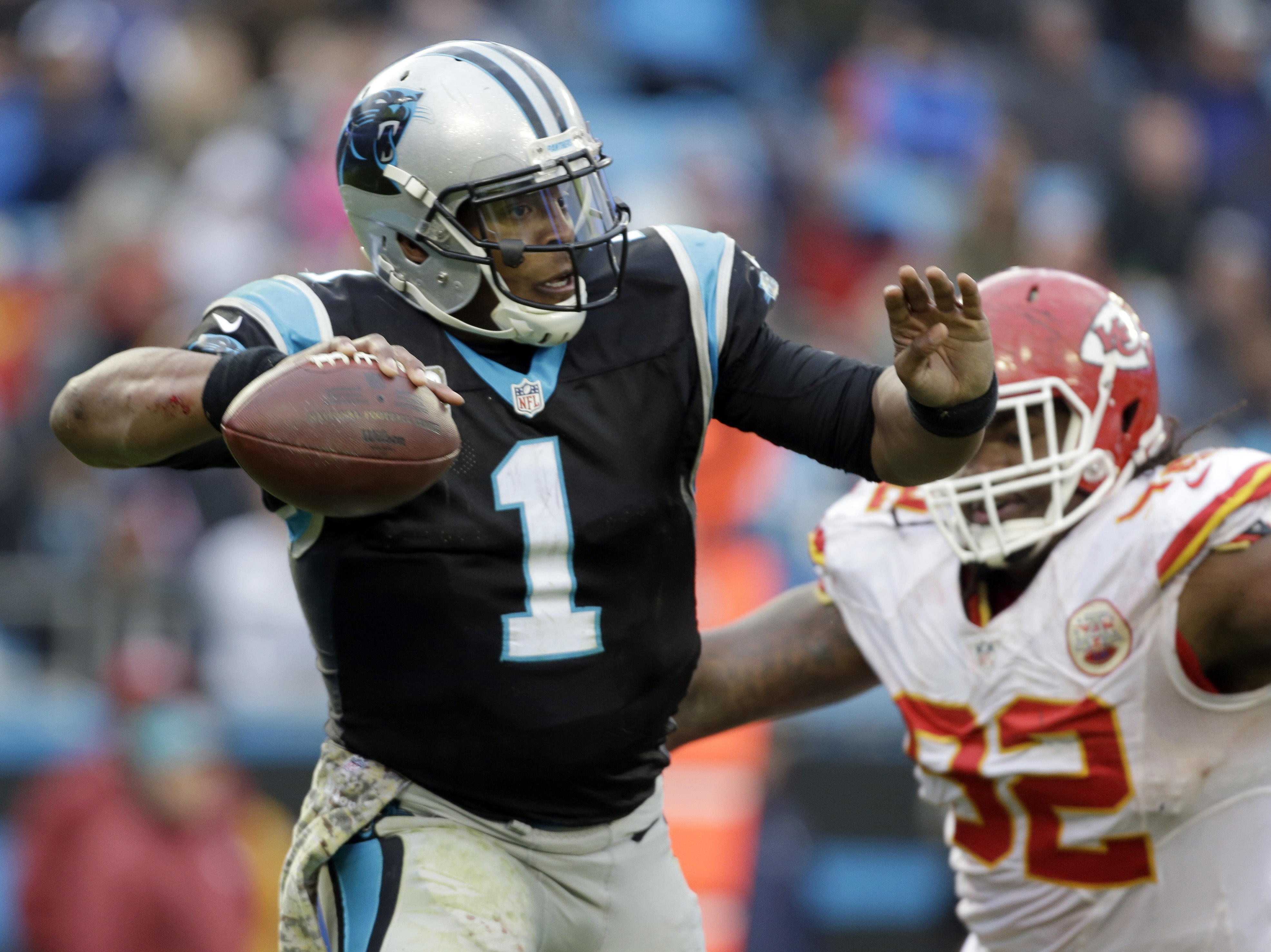 Carolina Panthers' Cam Newton (1) looks to pass under pressure from Kansas City Chiefs' Dontari Poe (92) in the second half of an NFL football game in Charlotte, N.C., Sunday, Nov. 13, 2016. (AP Photo/Bob Leverone)