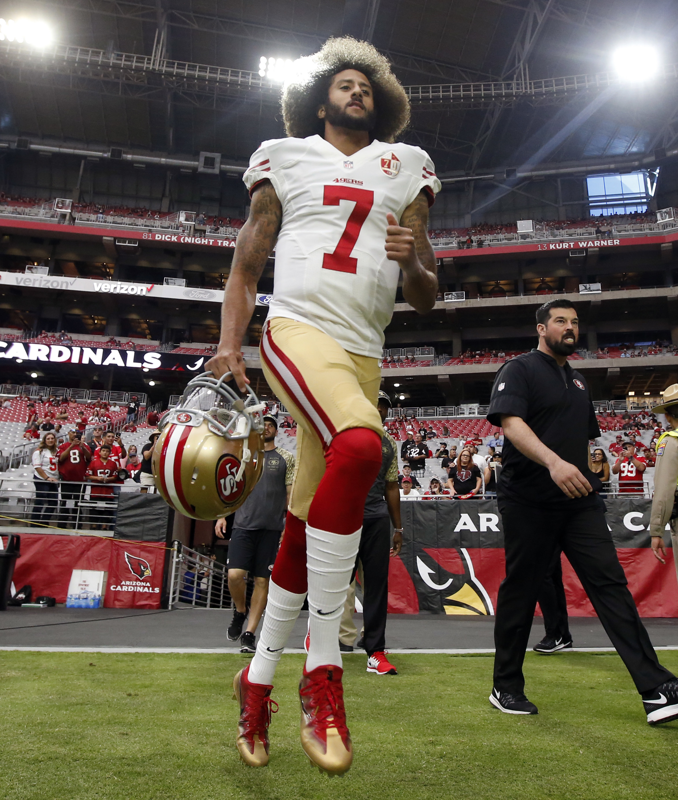 San Francisco 49ers quarterback Colin Kaepernick (7) takes the field prior to an NFL football game against the Arizona Cardinals, Sunday, Nov. 13, 2016, in Glendale, Ariz. (AP Photo/Ross D. Franklin)