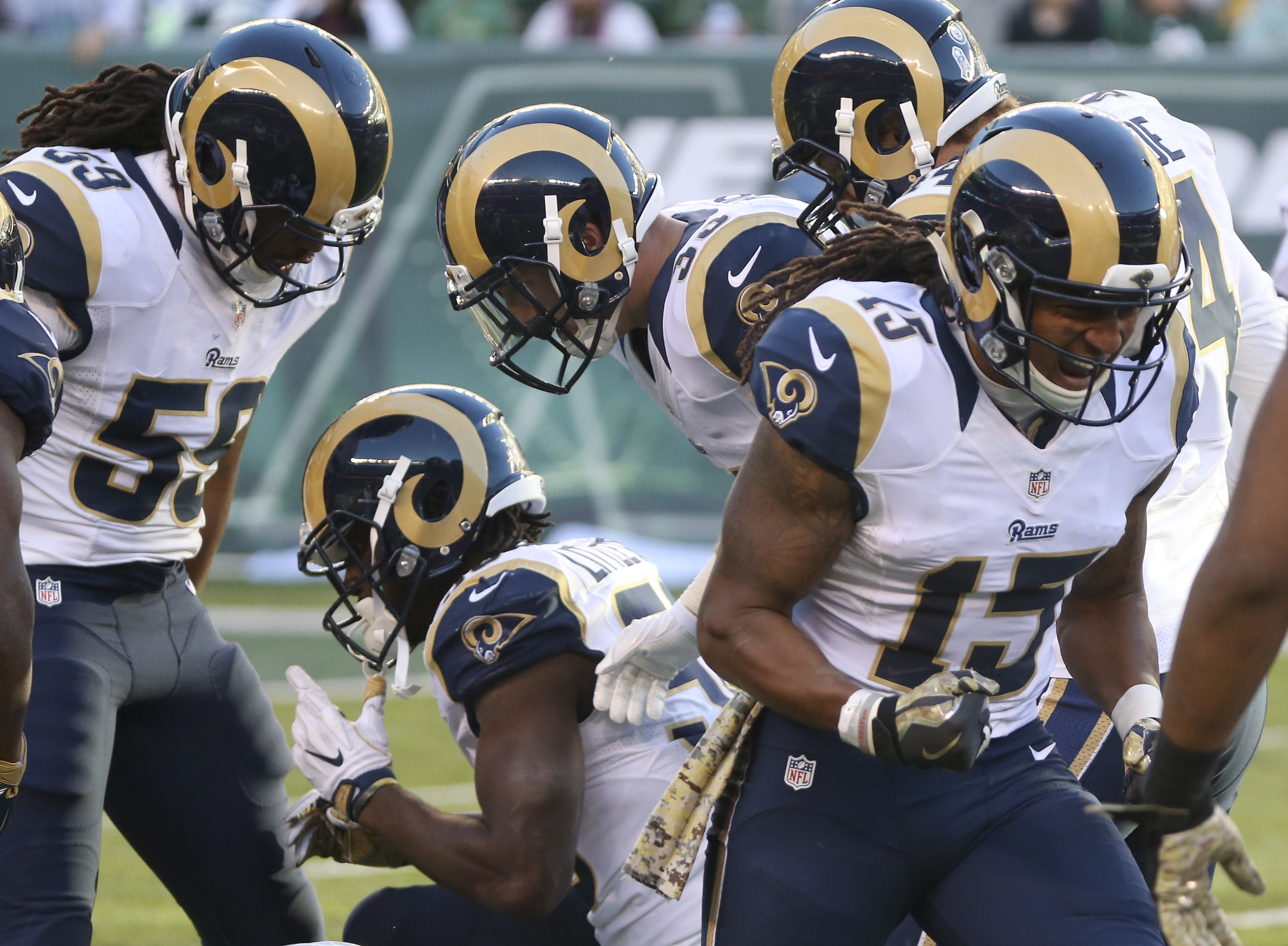 The Los Angeles Rams celebrate after a defensive play against the New York Jets during the fourth quarter of an NFL football game, Sunday, Nov. 13, 2016, in East Rutherford, N.J. (AP Photo/Seth Wenig)