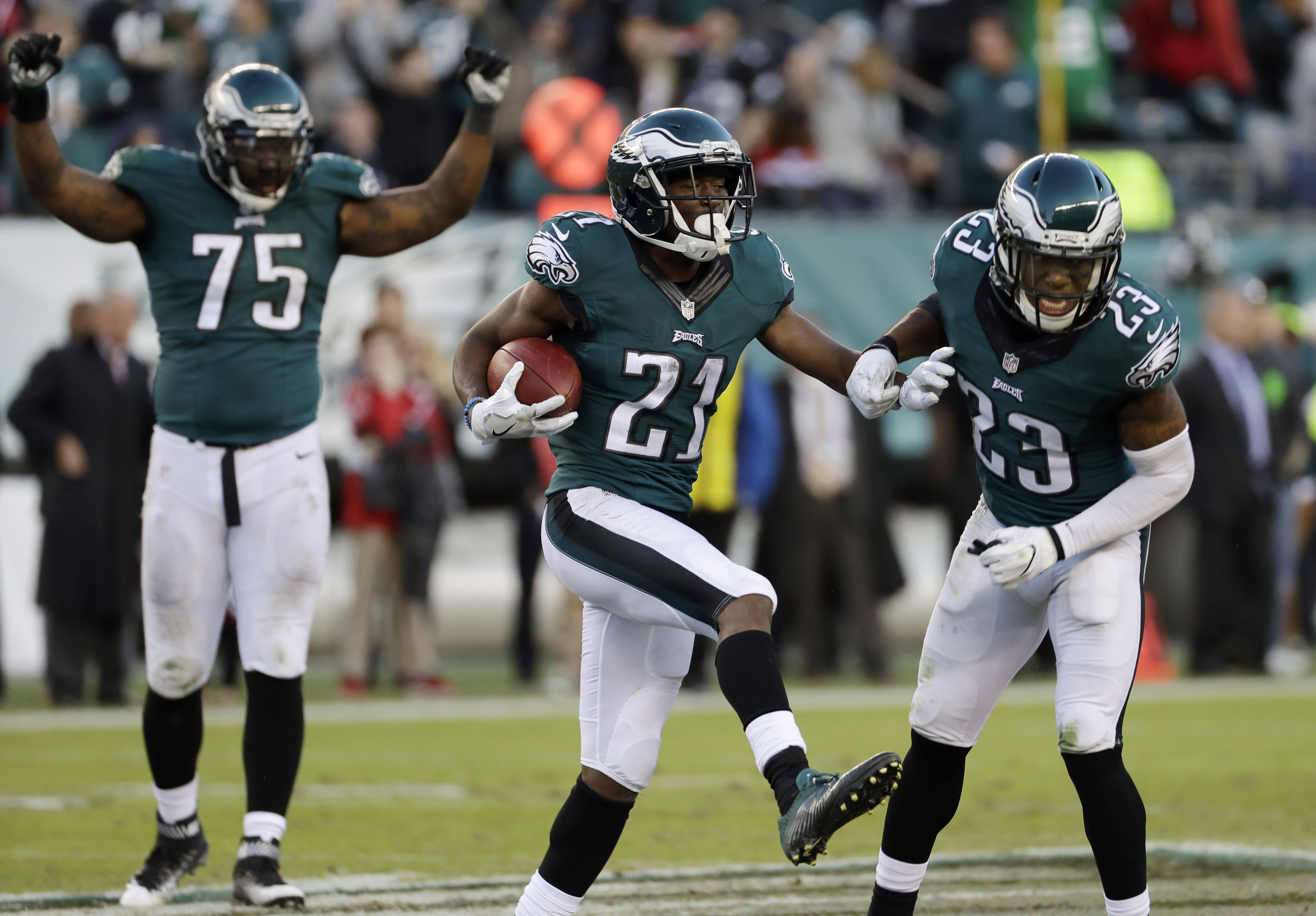 Philadelphia Eagles' Leodis McKelvin, center, celebrates an interception with Rodney McLeod, right, and Vinny Curry during the second half of an NFL football game against the Atlanta Falcons, Sunday, Nov. 13, 2016, in Philadelphia. (AP Photo/Michael Perez