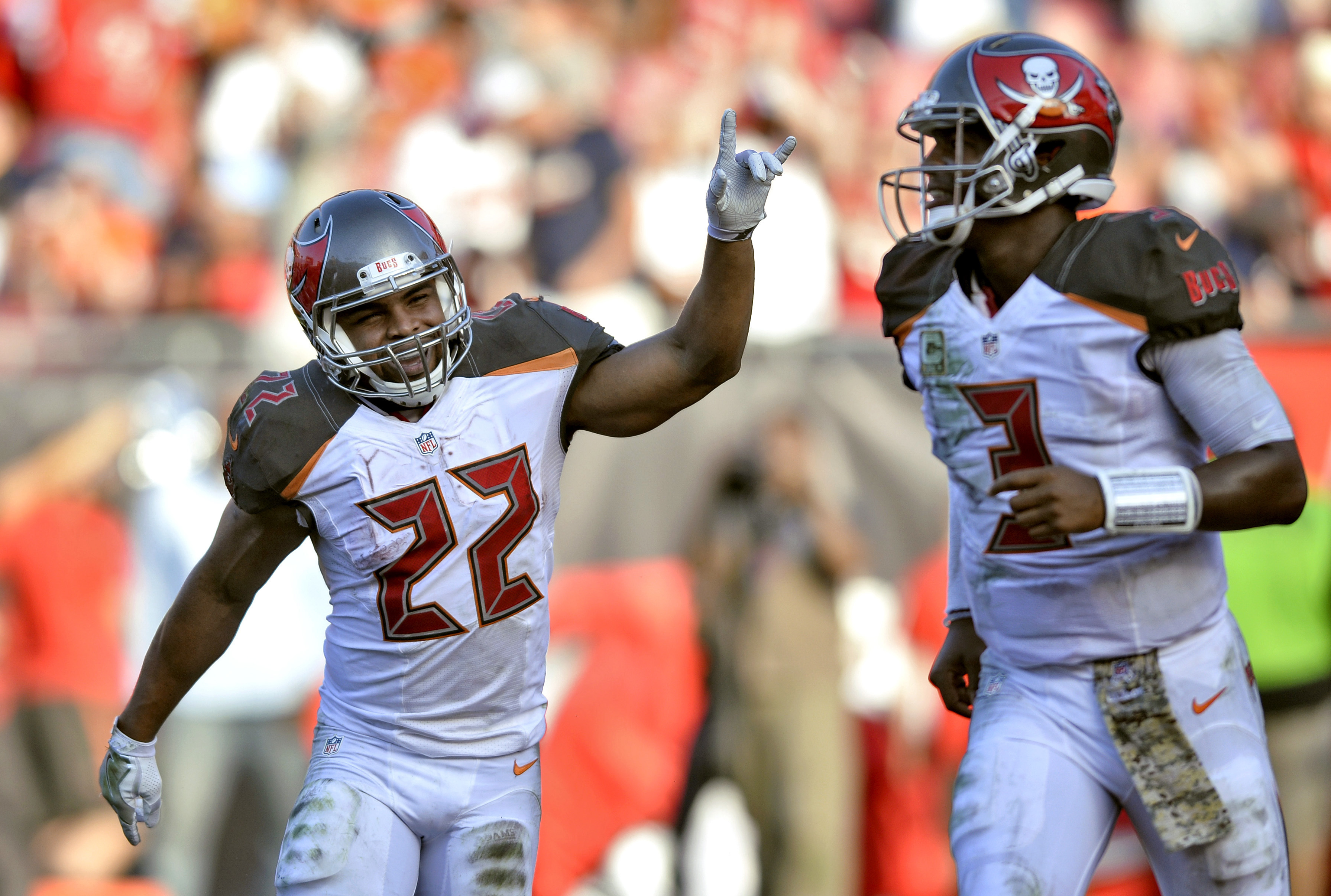 Tampa Bay Buccaneers running back Doug Martin (22) celebrates with quarterback Jameis Winston (3) after Martin's 1-yard touchdown run against the Chicago Bears during the fourth quarter of an NFL football game Sunday, Nov. 13, 2016, in Tampa, Fla. (AP Pho