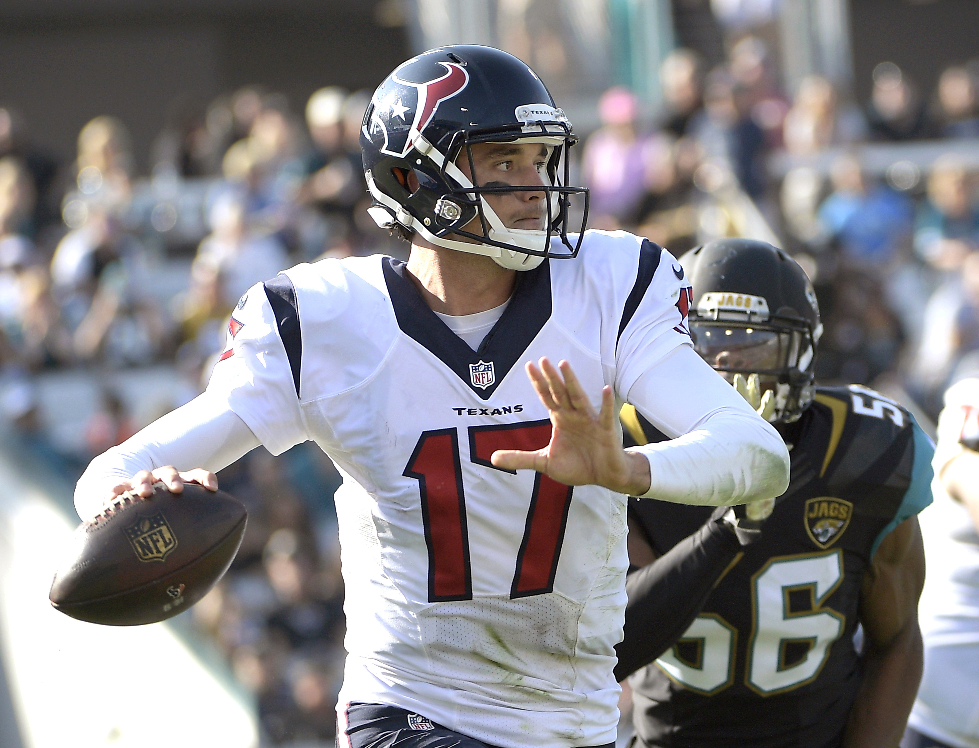 Houston Texans quarterback Brock Osweiler (17) scrambles out of the pocket as Jacksonville Jaguars defensive end Dante Fowler (56) gives chase during the second half of an NFL football game in Jacksonville, Fla., Sunday, Nov. 13, 2016. (AP Photo/Phelan M.