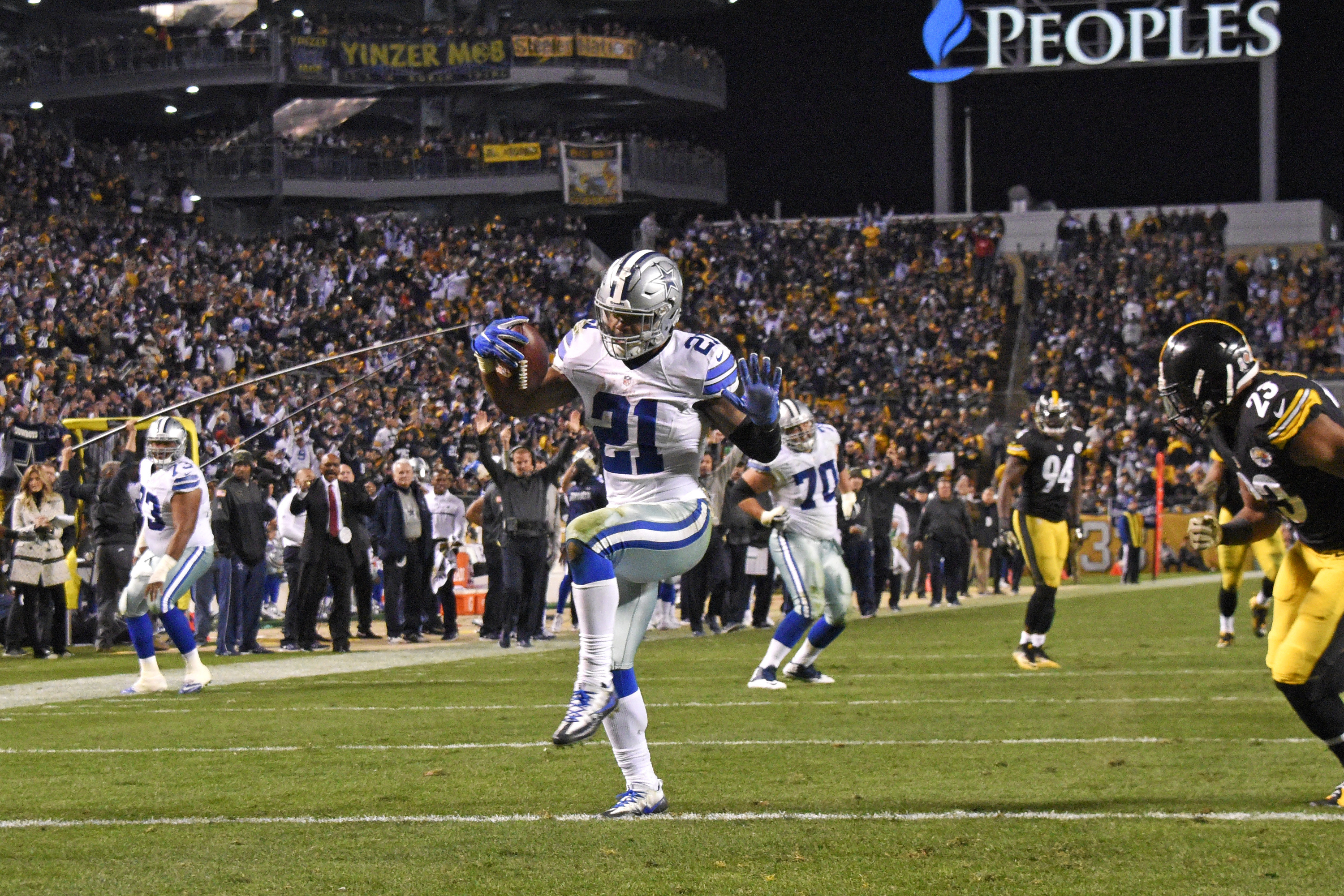 Dallas Cowboys running back Ezekiel Elliott (21) dances into the end zone ahead of Pittsburgh Steelers free safety Mike Mitchell (23) for a game-winning touchdown during the second half of an NFL football game in Pittsburgh, Sunday, Nov. 13, 2016. The Cow