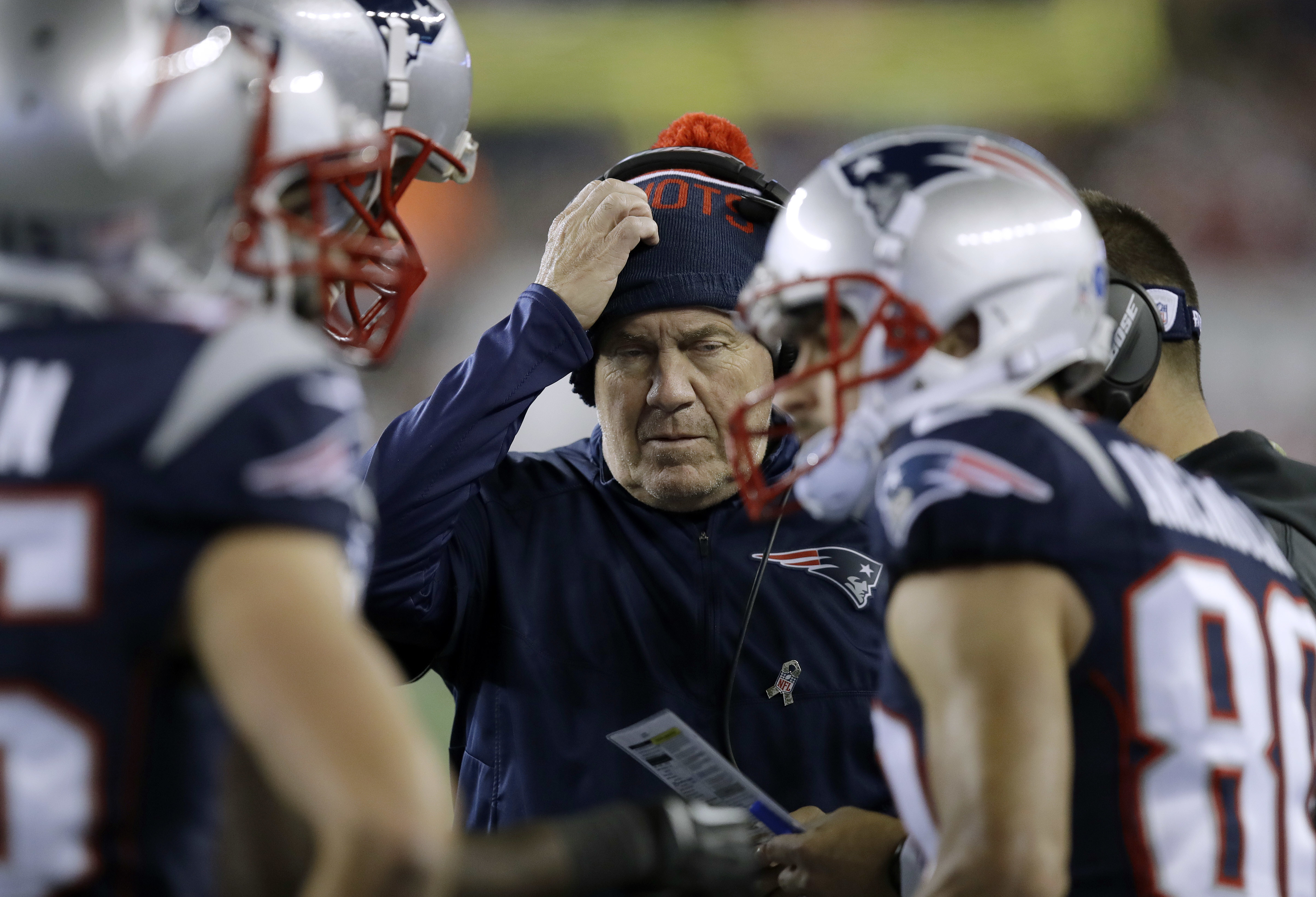 New England Patriots head coach Bill Belichick, center, talks with his team on the sideline during the first half of an NFL football game against the Seattle Seahawks, Sunday, Nov. 13, 2016, in Foxborough, Mass. (AP Photo/Charles Krupa)