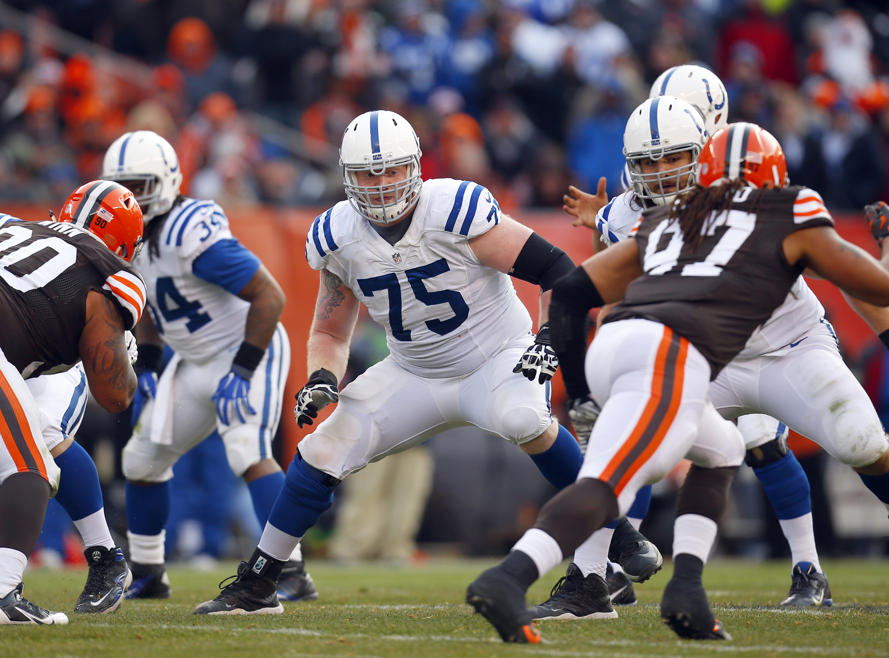 FILE - In this Dec. 7, 2014, file photo, Indianapolis Colts guard Jack Mewhort (75) sets to block against the Cleveland Browns during an NFL football game, in Cleveland. Coach Chuck Pagano did not speak with reporters Monday, Nov. 14, 2016, but what happe