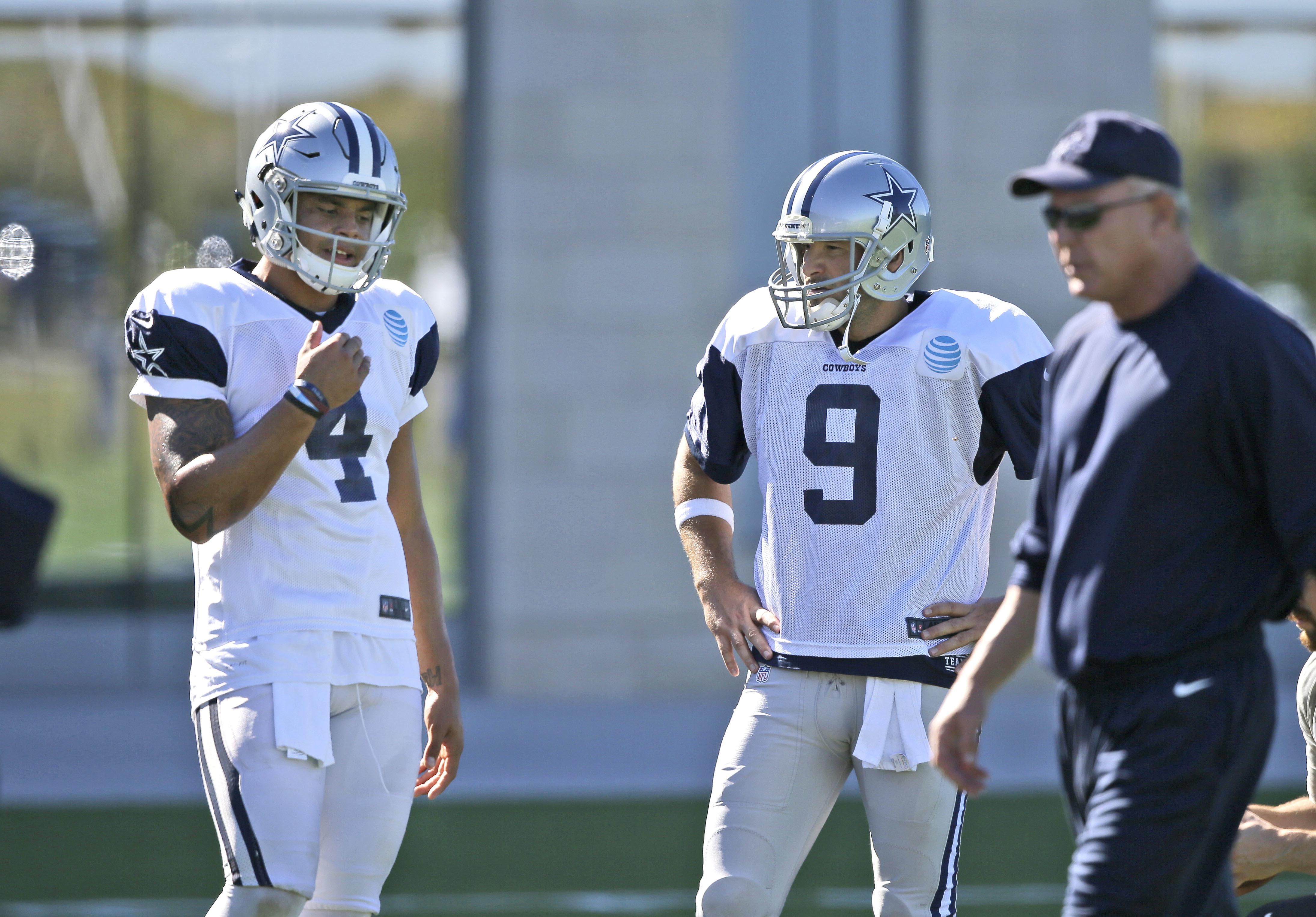 Dallas Cowboys starting quarterback Dak Prescott (4) and backup quarterback Tony Romo stand on the field during an NFL football team practice in Frisco, Texas, Wednesday, Nov. 16, 2016. Prescott frequently said the Dallas Cowboys were still Romo's team ev