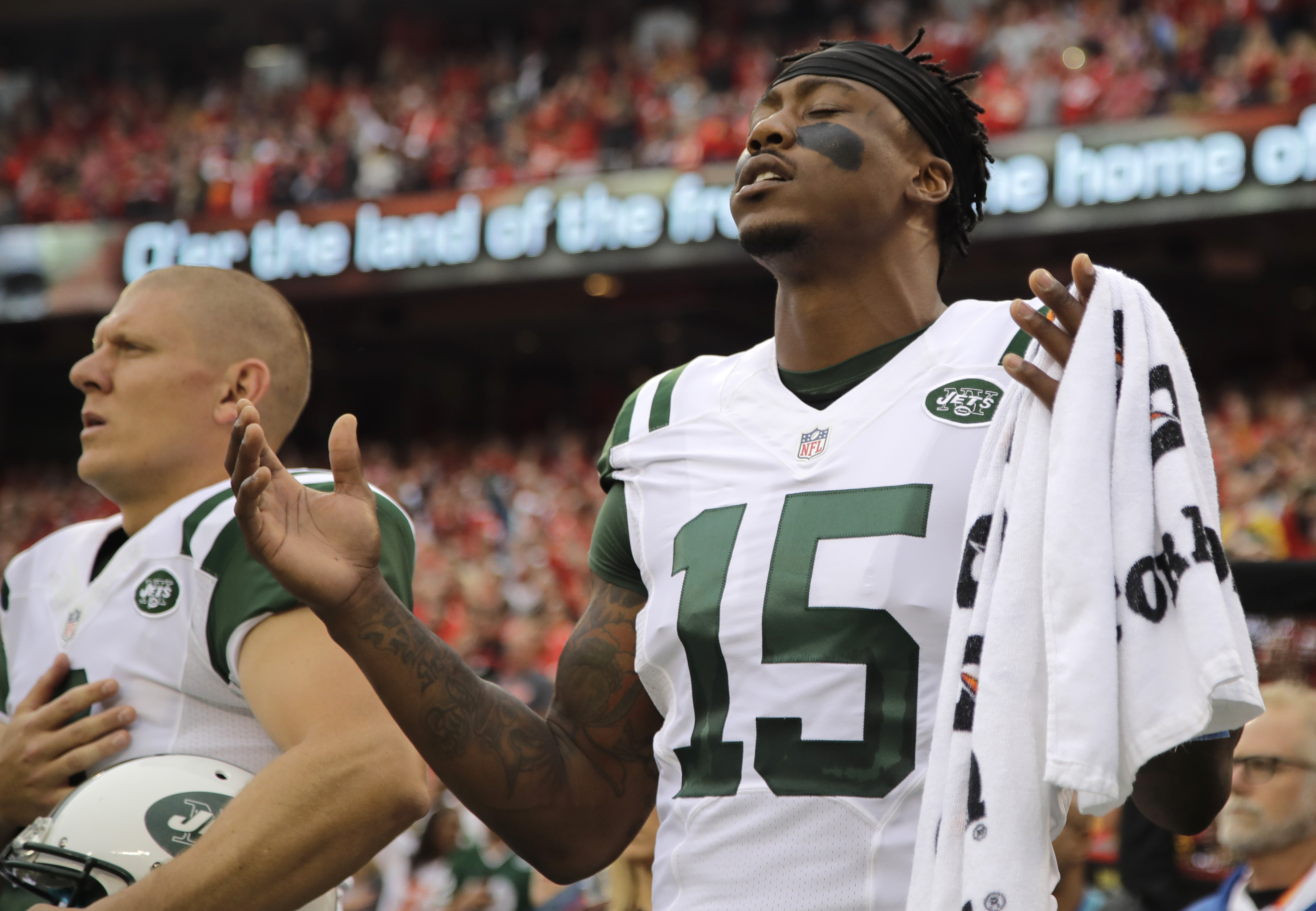FILE - In this Sept.; 25, 2016, file photo, New York Jets wide receiver Brandon Marshall (15) gestures during the playing of the national anthem before an NFL football game against the Kansas City Chiefs,  in Kansas City, Mo. The cornerstones are crumblin