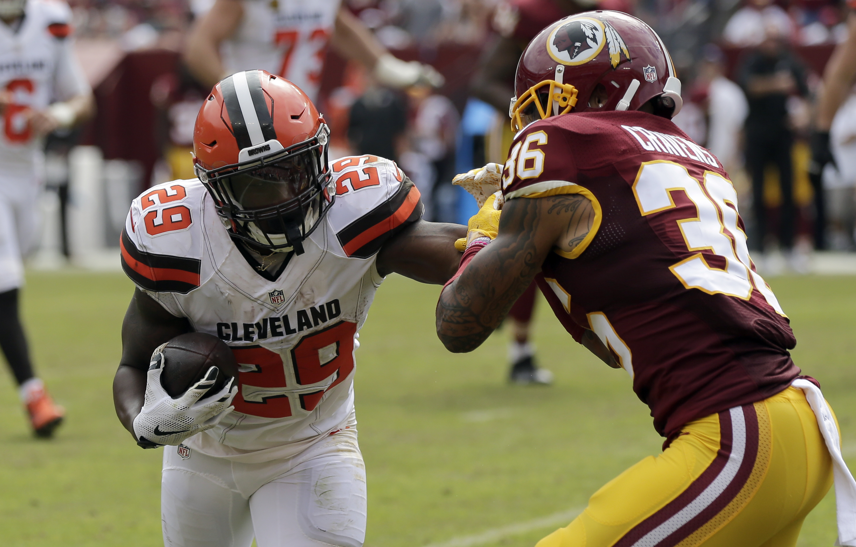 In this photo taken Oct. 2, 2016, Washington Redskins defensive back Su'a Cravens (36) attempts to tackle Cleveland Browns running back Duke Johnson (29) during the first half of an NFL football game in Landover, Md. Cravens figured out a few practices in