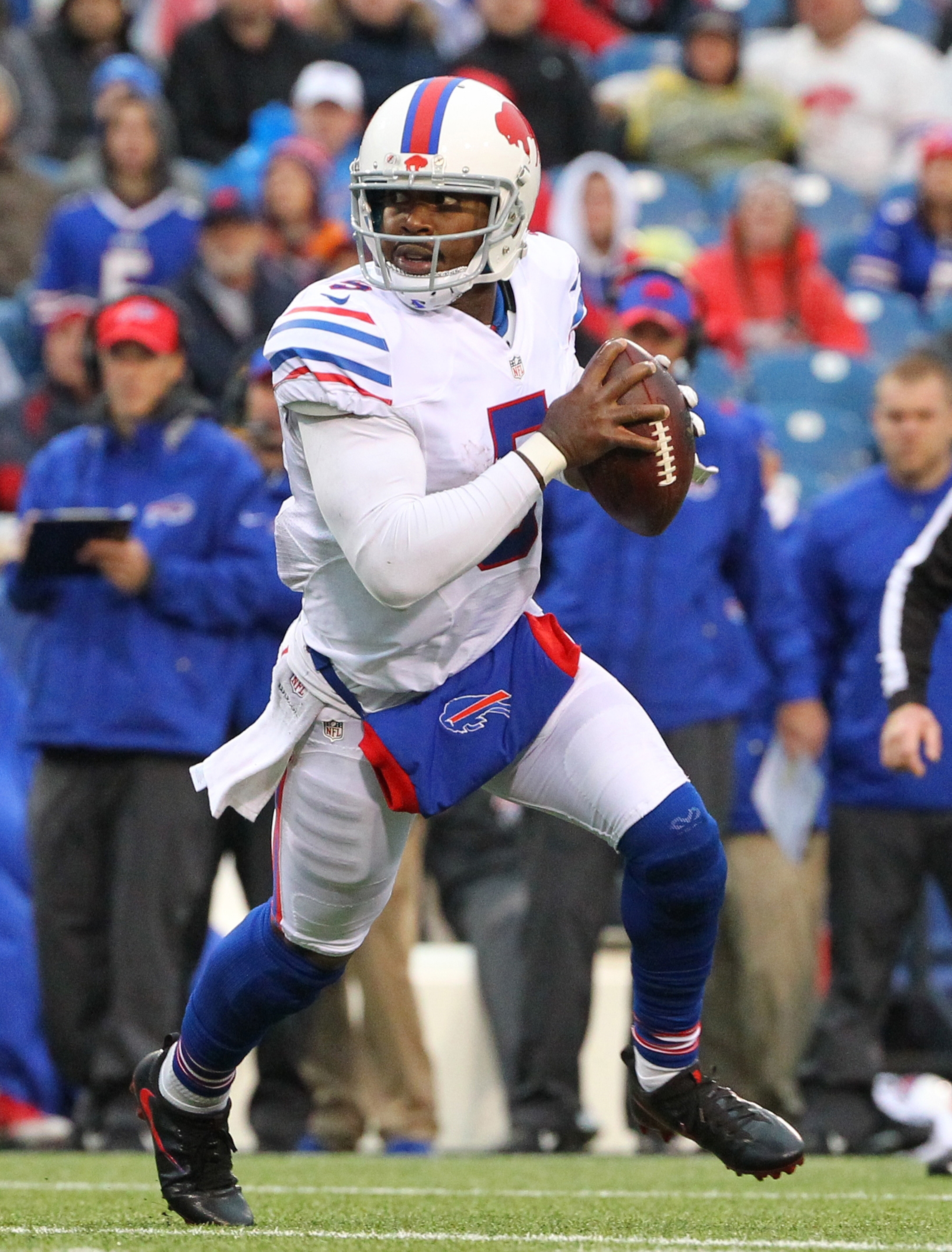 FILE - In this Oct. 30, 2016, file photo, Buffalo Bills quarterback Tyrod Taylor (5) runs with the ball during the second half of an NFL football game against the New England Patriots, in Orchard Park, N.Y. The Buffalo Bills host the Bengals on Sunday. (A