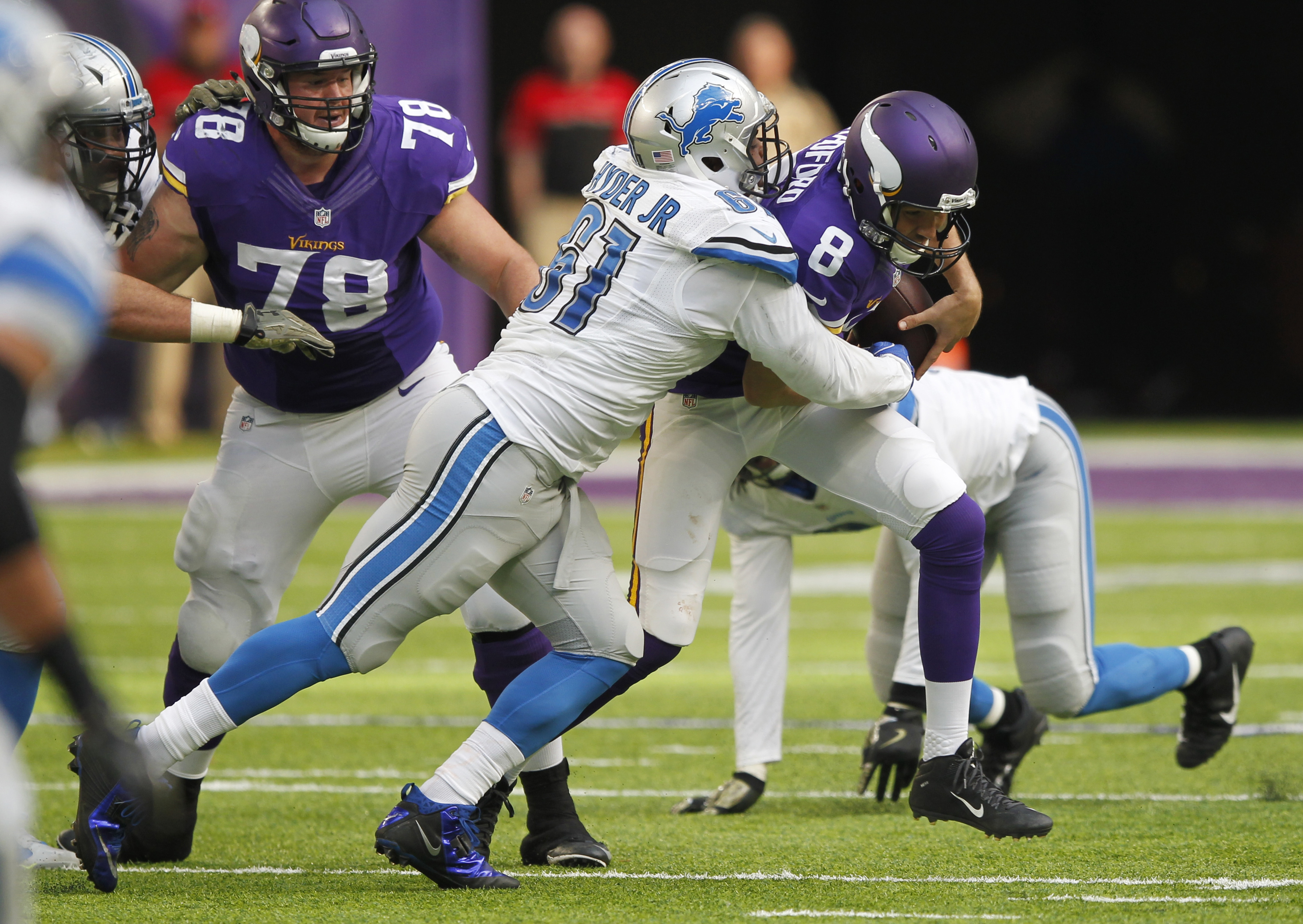 FILE - In this Nov. 6, 2016, file photo, Minnesota Vikings quarterback Sam Bradford (8) is sacked by Detroit Lions defensive end Kerry Hyder, left, during the second half of an NFL football game, in Minneapolis. Overshadowed by the injuries and ineffectiv