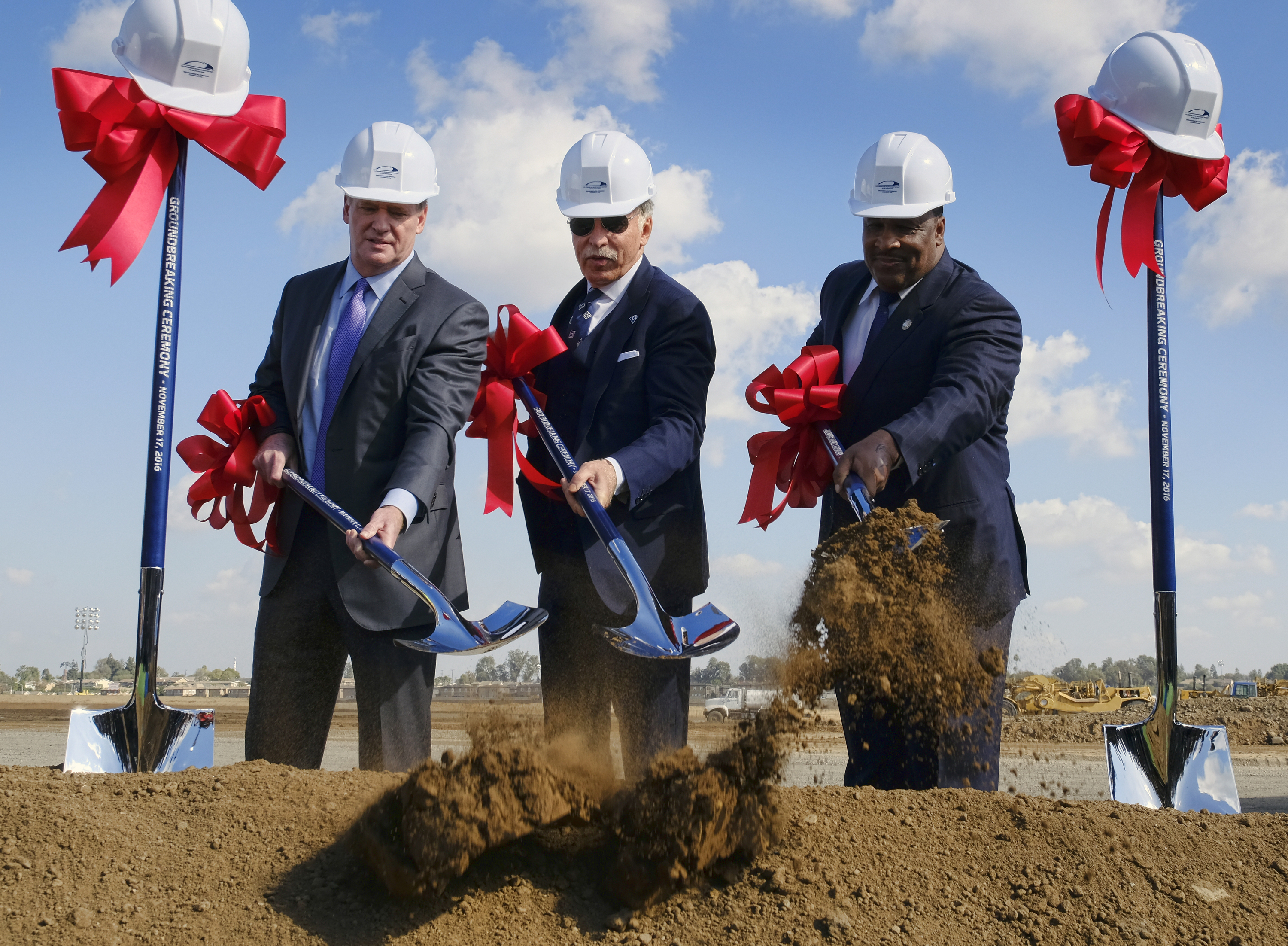 NFL Commissioner Roger Goodell, left, joins Los Angeles Rams owner Stan Kroenke, center, and Inglewood Mayor James T. Butts Jr. during groundbreaking ceremonies for the team's new stadium in Inglewood, Calif., Thursday, Nov. 17, 2016. (AP Photo/Richard Vo