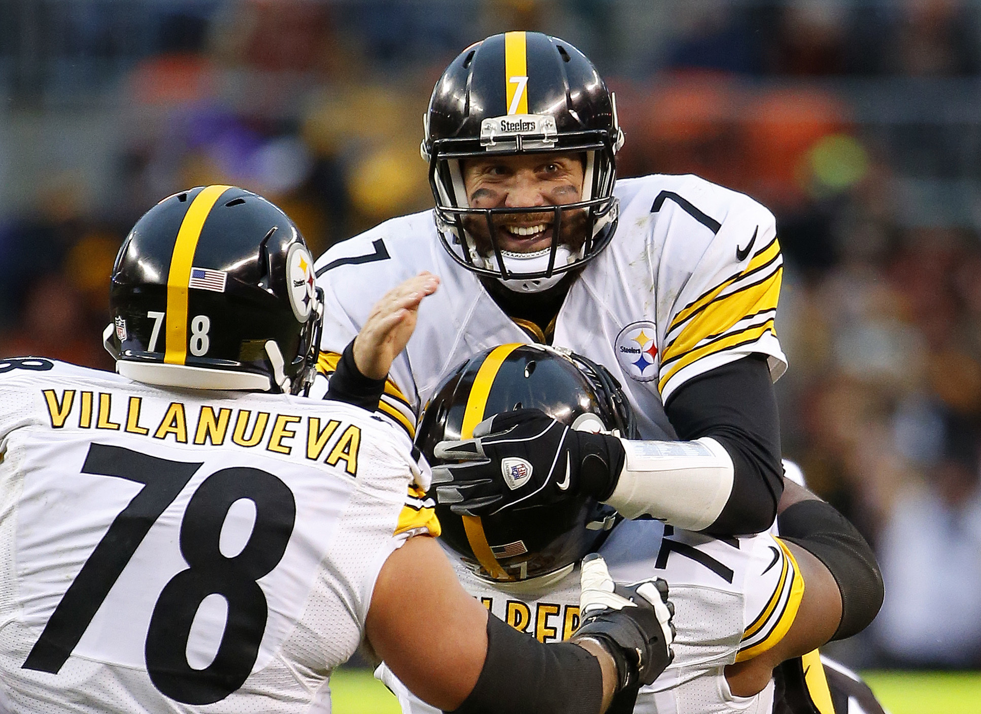 FILE - In this Jan. 3, 2016, file photo, Pittsburgh Steelers quarterback Ben Roethlisberger celebrates a touchdown pass against the Cleveland Browns with tackle Marcus Gilbert (77) and Alejandro Villanueva (78) during an NFL football game in Cleveland, Oh