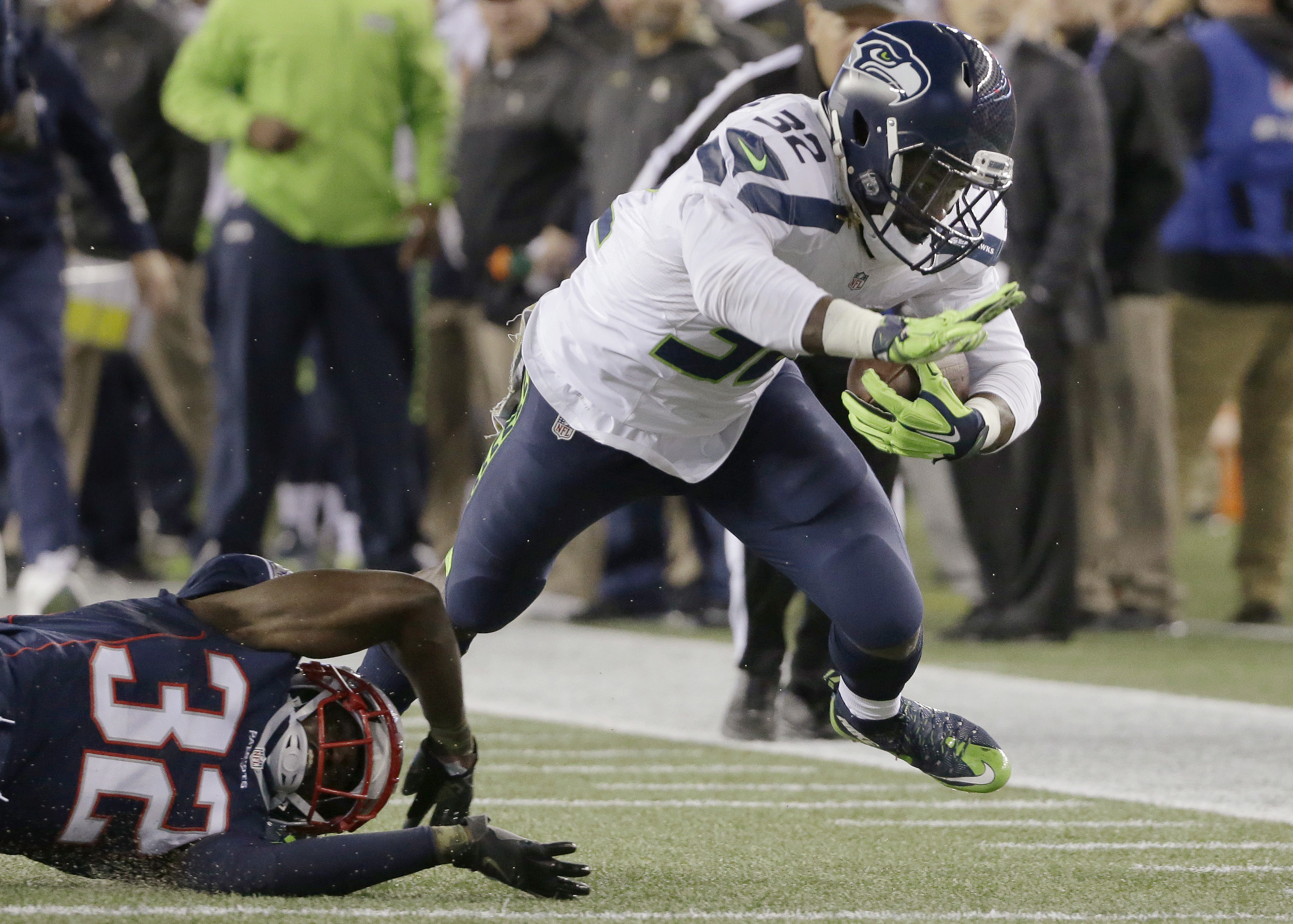 FILE - In this Nov. 13, 2016, file photo, Seattle Seahawks running back Christine Michael, right, eludes New England Patriots defensive back Devin McCourty, left, during the first half of an NFL football game in Foxborough, Mass. In Clay Matthews and now