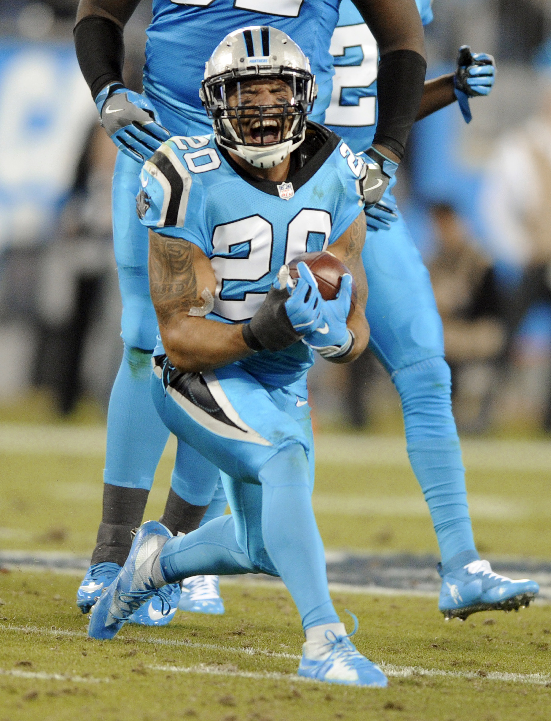 Carolina Panthers' Kurt Coleman (20) reacts to intercepting a New Orleans Saints pass in the first half of an NFL football game in Charlotte, N.C., Thursday, Nov. 17, 2016. (AP Photo/Mike McCarn)