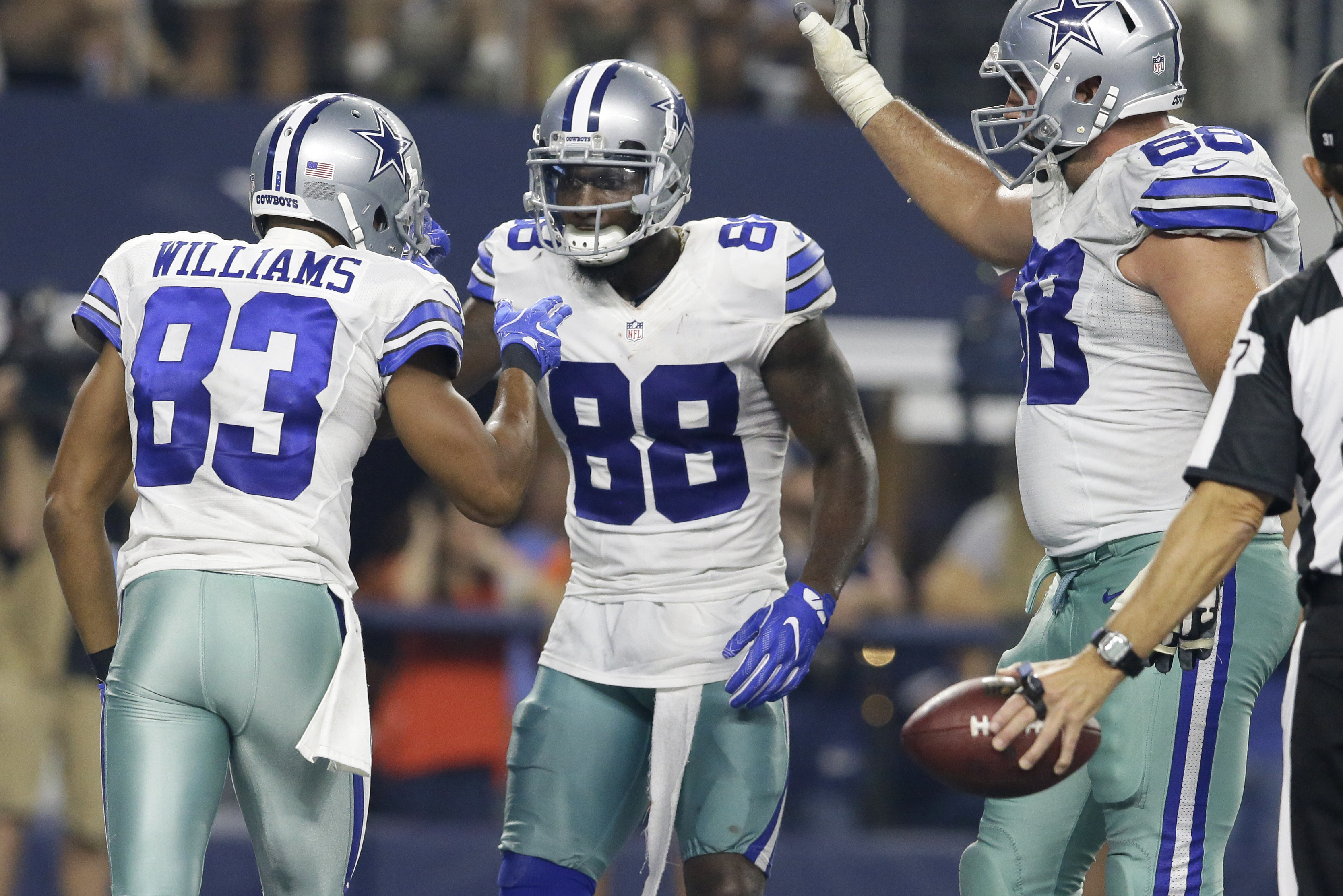FILE - In this Sept. 25, 2016, file photo, Dallas Cowboys' Terrance Williams (83), Dez Bryant (88) and Doug Free (68) celebrate a touchdown catch by Bryant in the second half of an NFL football game against the Chicago Bears, in Arlington, Texas. Bryant s