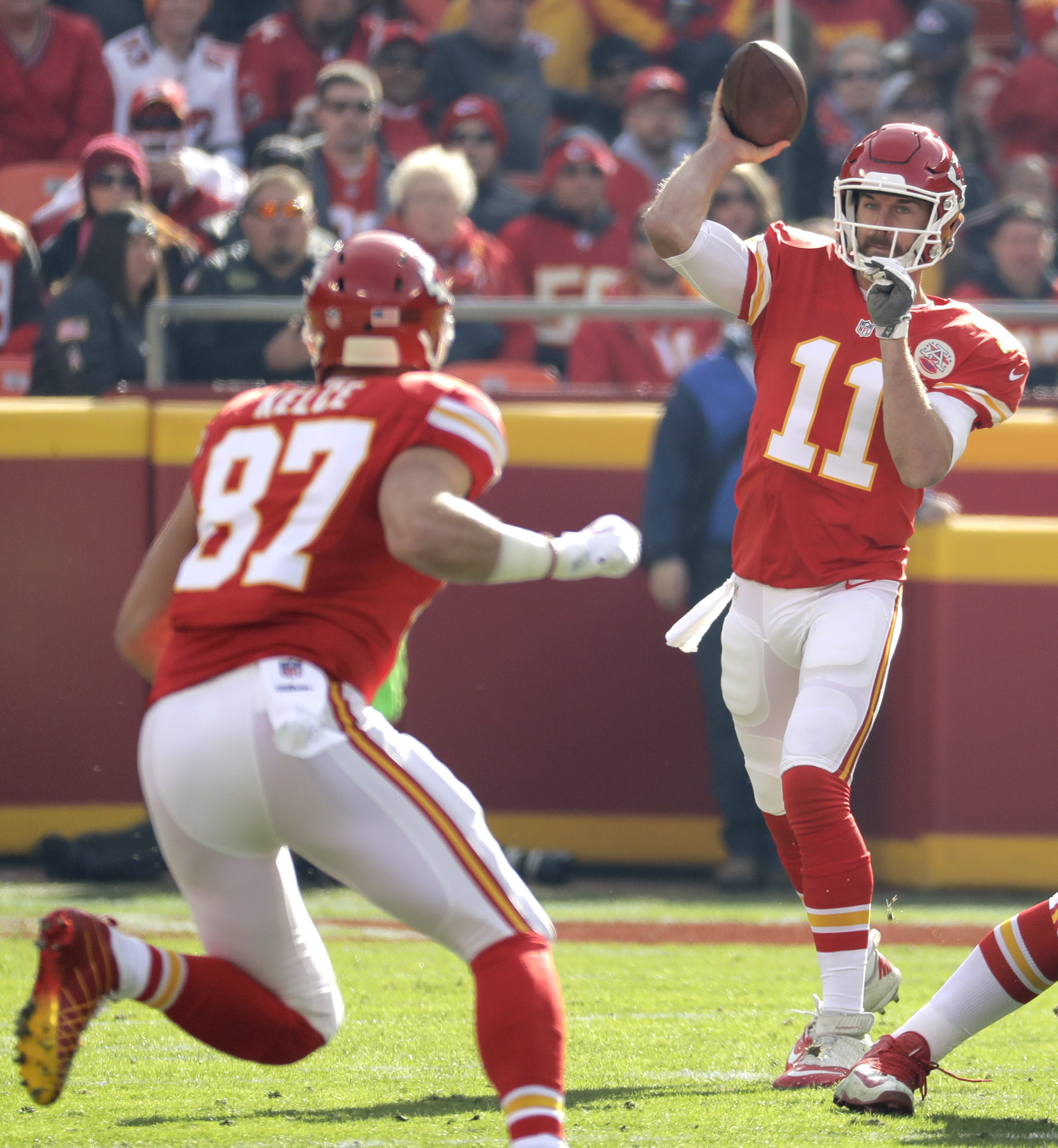 Kansas City Chiefs quarterback Alex Smith (11) throws to tight end Travis Kelce (87) during the first half of an NFL football game against the Tampa Bay Buccaneers in Kansas City, Mo., Sunday, Nov. 20, 2016. (AP Photo/Charlie Riedel)
