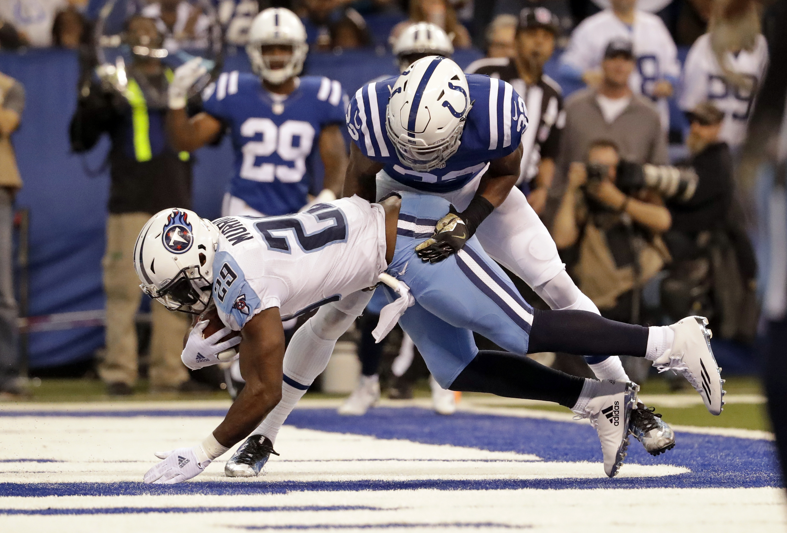 Tennessee Titans running back DeMarco Murray (29) makes a catch under Indianapolis Colts safety T.J. Green (32) for a touchdown during the first half of an NFL football game in Indianapolis, Sunday, Nov. 20, 2016. (AP Photo/Jeff Roberson)