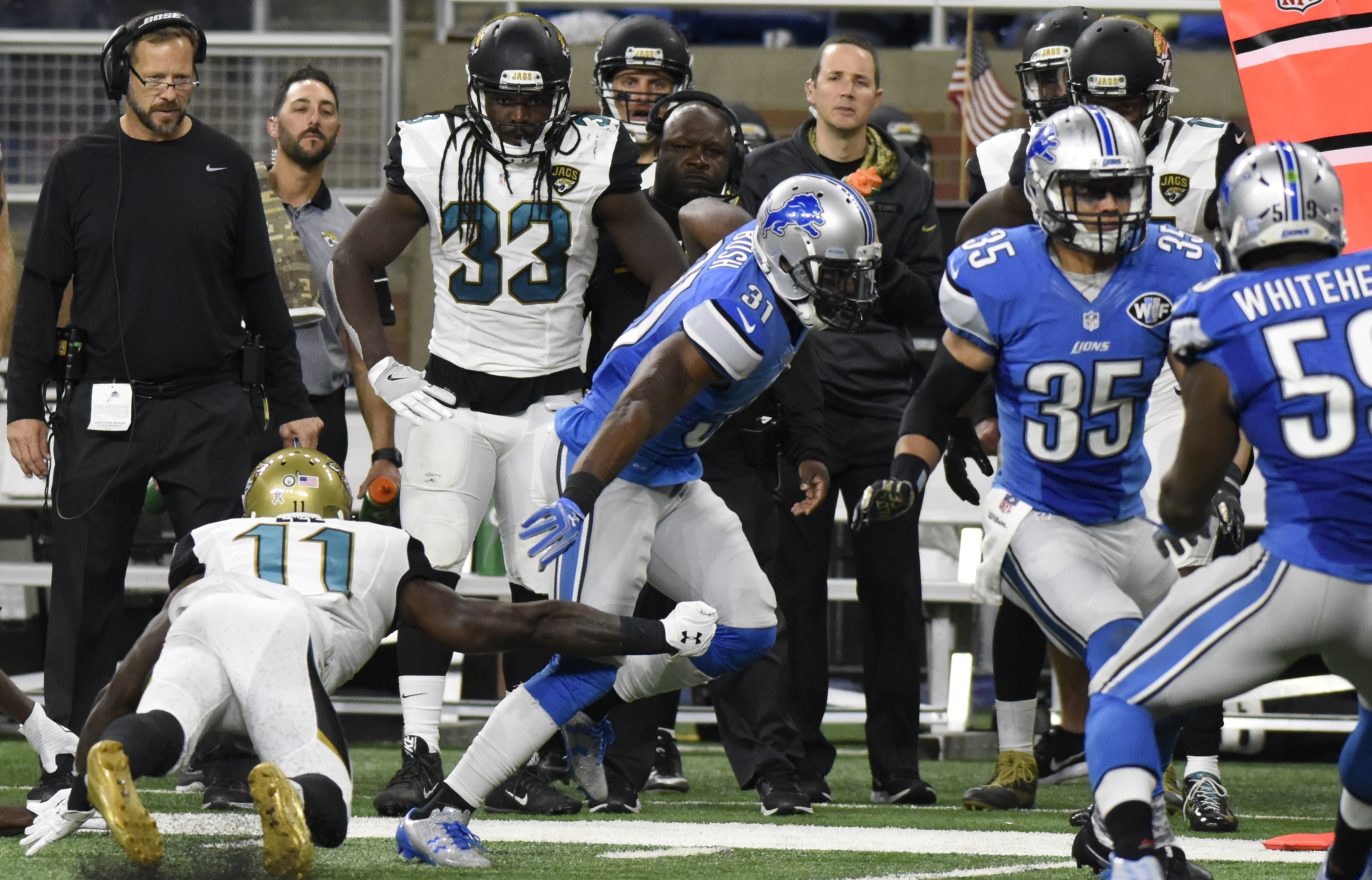 Detroit Lions strong safety Rafael Bush (31) runs an interception back for a 39-yard touchdown during the second half of an NFL football game against the Jacksonville Jaguars, Sunday, Nov. 20, 2016 in Detroit. (AP Photo/Jose Juarez)