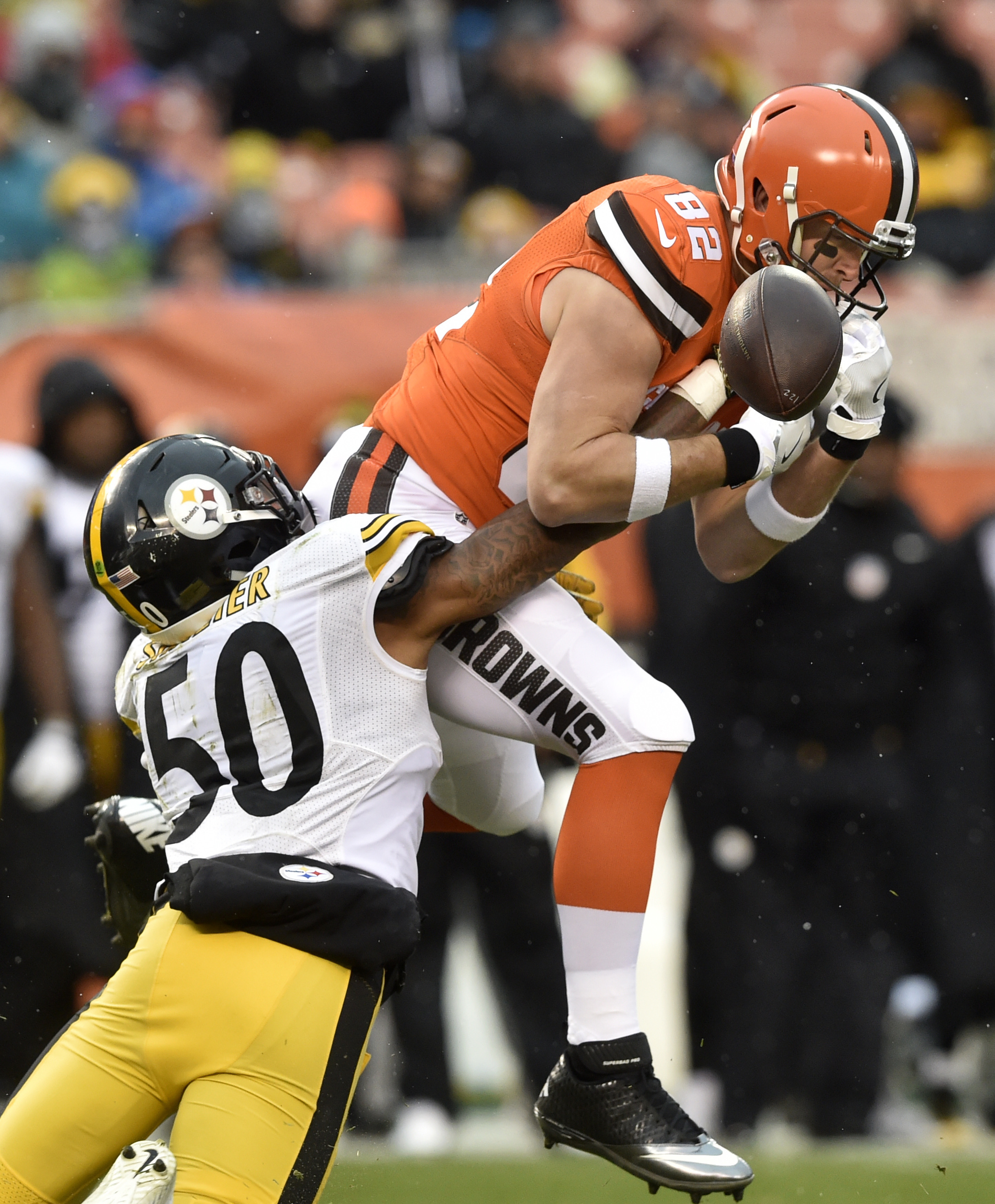 Cleveland Browns tight end Gary Barnidge (82) can't hang on to the ball as he is hit by Pittsburgh Steelers inside linebacker Ryan Shazier (50) during the second half of an NFL football game in Cleveland, Sunday, Nov. 20, 2016. (AP Photo/David Richard)