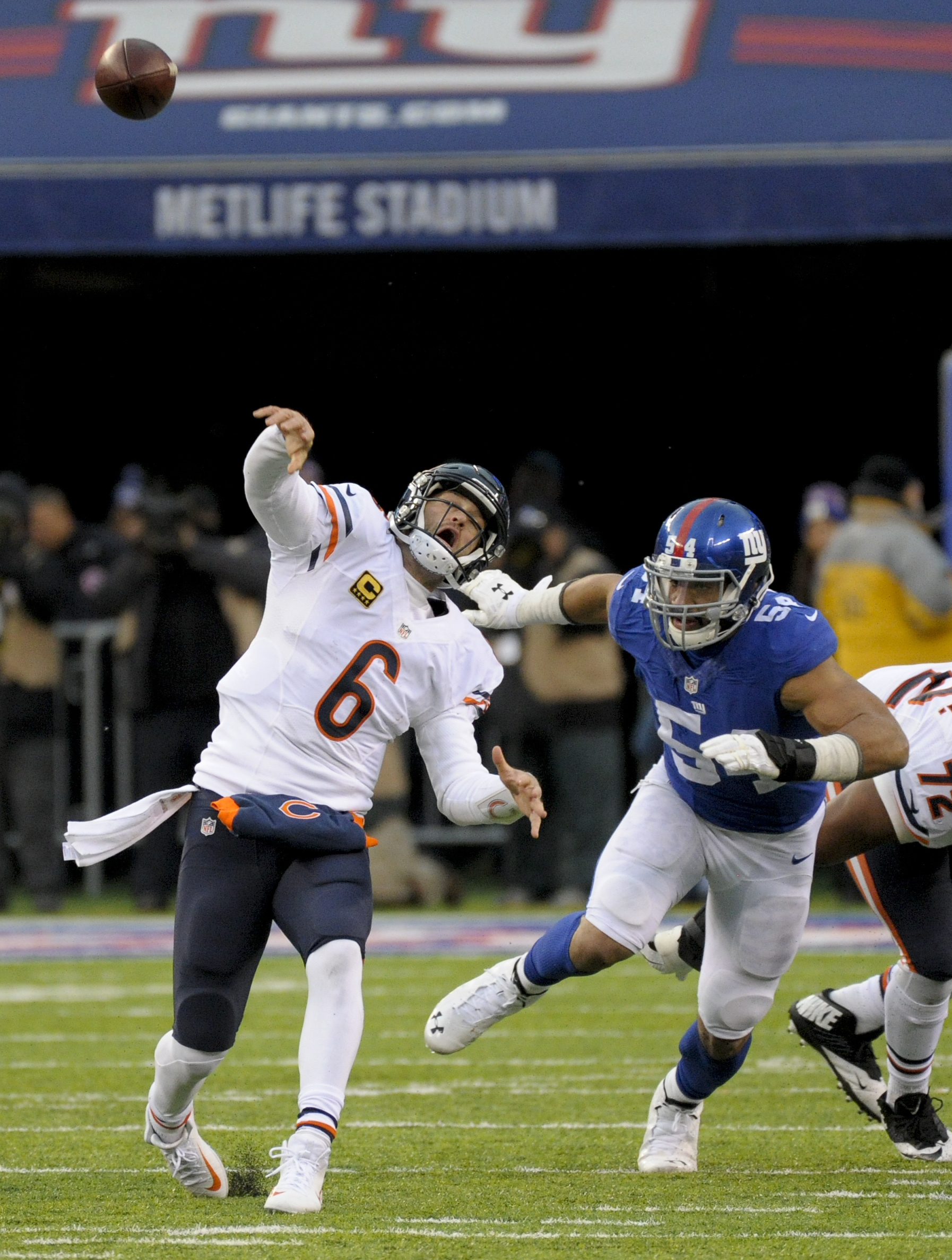 Chicago Bears quarterback Jay Cutler (6) throws under pressure from New York Giants defensive end Olivier Vernon (54) during the fourth quarter of an NFL football game, Sunday, Nov. 20, 2016, in East Rutherford, N.J. Cutler threw an interception on the pl