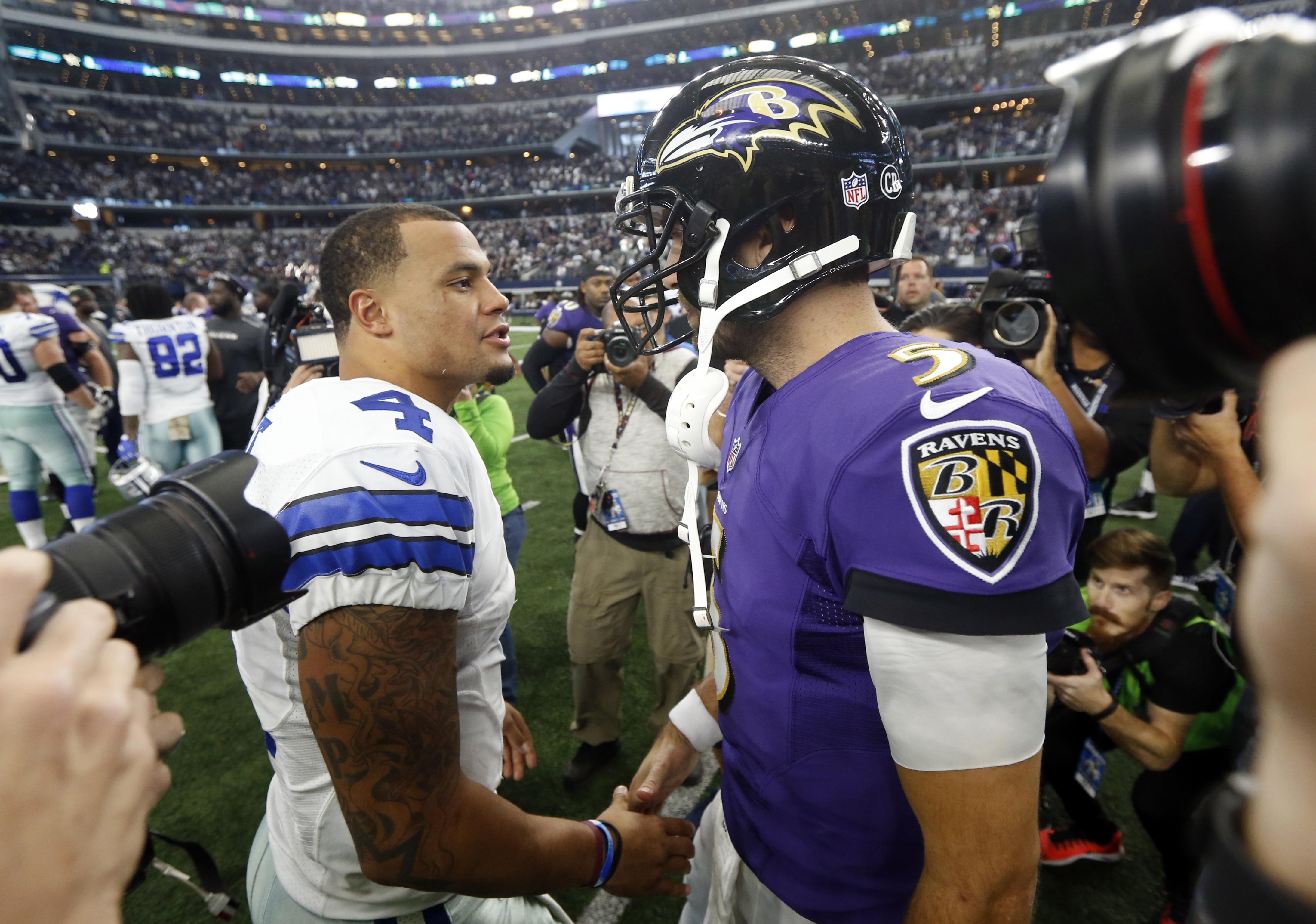 Dallas Cowboys quarterback Dak Prescott (4) and Baltimore Ravens quarterback Joe Flacco (5) greet each other after their NFL football game, Sunday, Nov. 20, 2016, in Arlington, Texas. (AP Photo/Michael Ainsworth)